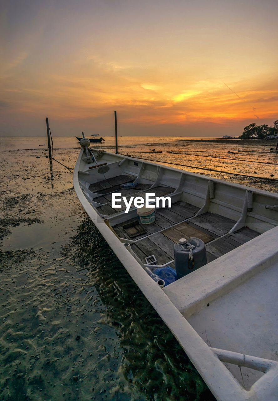 sunset, sky, water, nautical vessel, transportation, mode of transportation, moored, beauty in nature, cloud - sky, sea, scenics - nature, beach, nature, orange color, land, no people, tranquility, tranquil scene, outrigger, fishing boat, rowboat