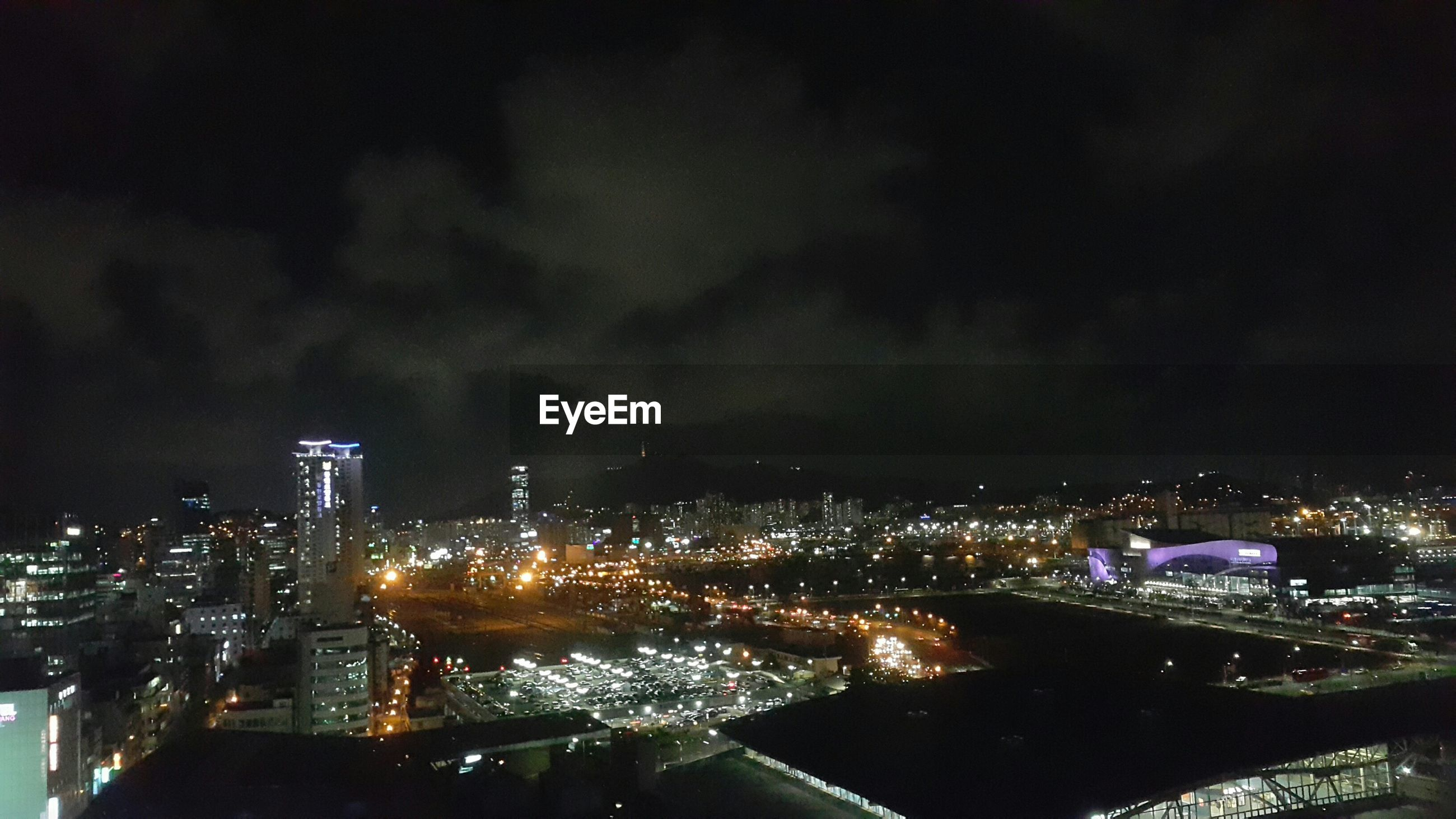 architecture, night, city, illuminated, building exterior, built structure, cityscape, sky, high angle view, crowded, skyscraper, residential district, modern, residential building, city life, river, cloud - sky, tower, no people, development