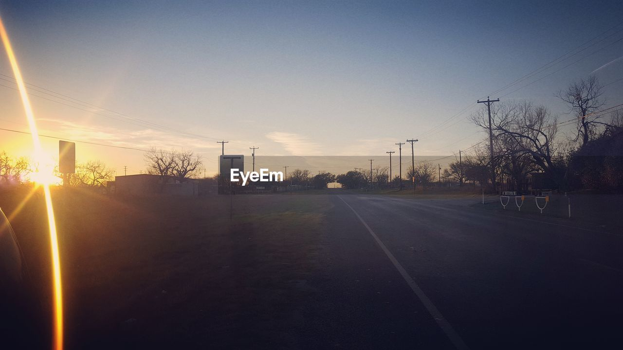 road, sun, sunset, lens flare, transportation, the way forward, no people, sky, tree, outdoors, sunlight, clear sky, nature, day