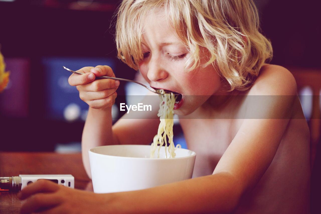 Shirtless Boy Having Noodles