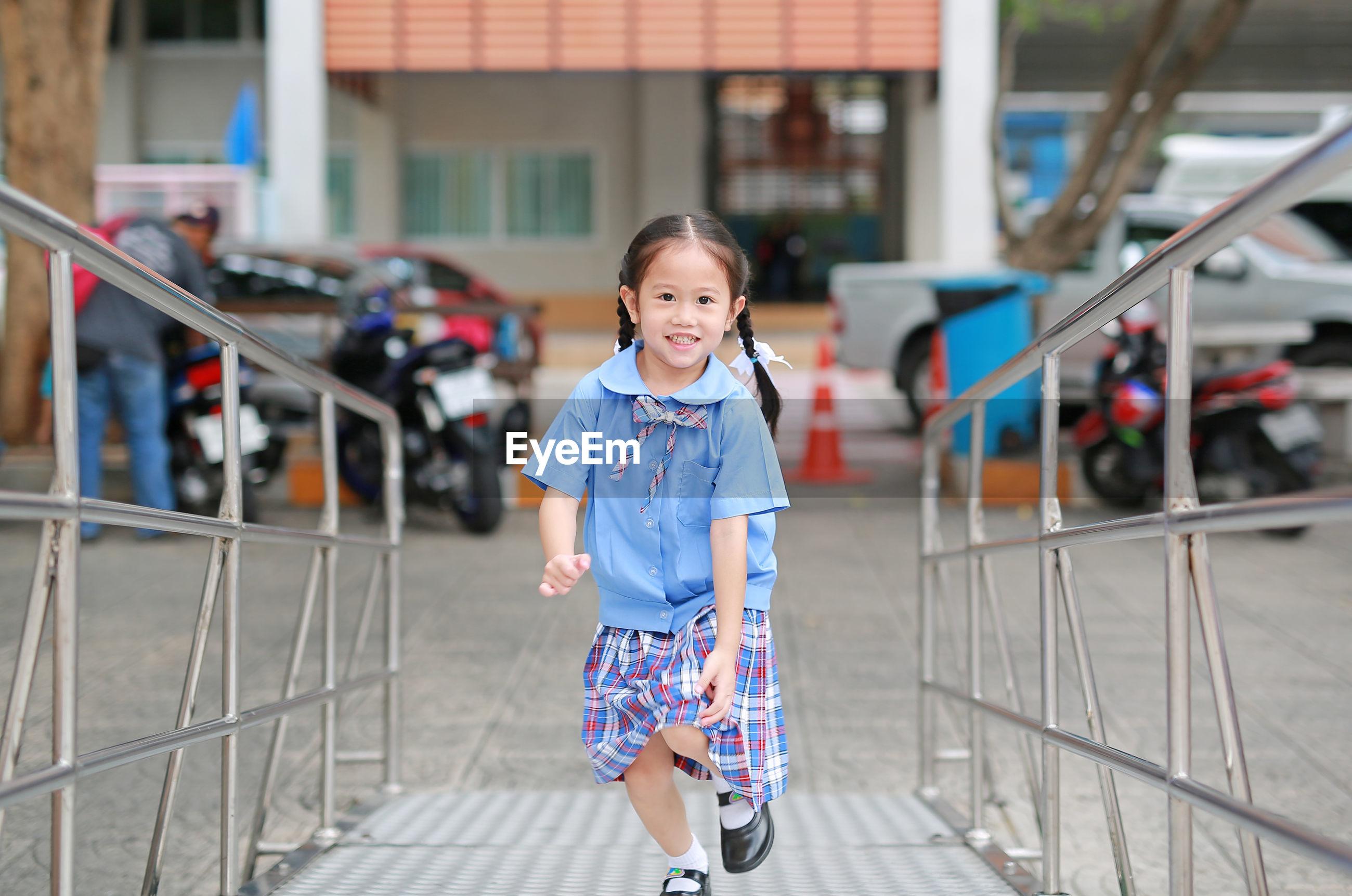 Portrait of cute girl running outdoors
