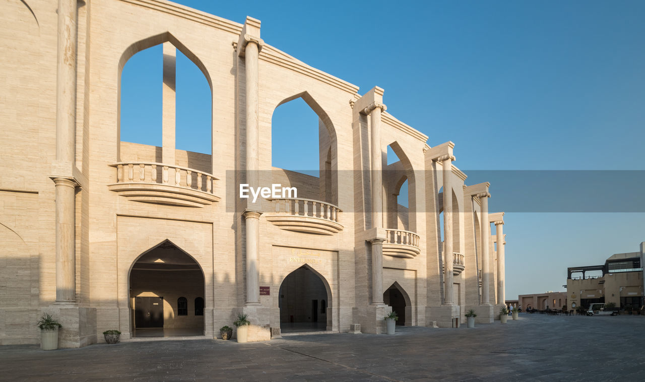 built structure, architecture, building exterior, arch, sky, clear sky, building, the past, history, nature, day, no people, travel destinations, religion, sunlight, outdoors, belief, place of worship, tourism, entrance, architectural column, arched, ancient civilization, courtyard