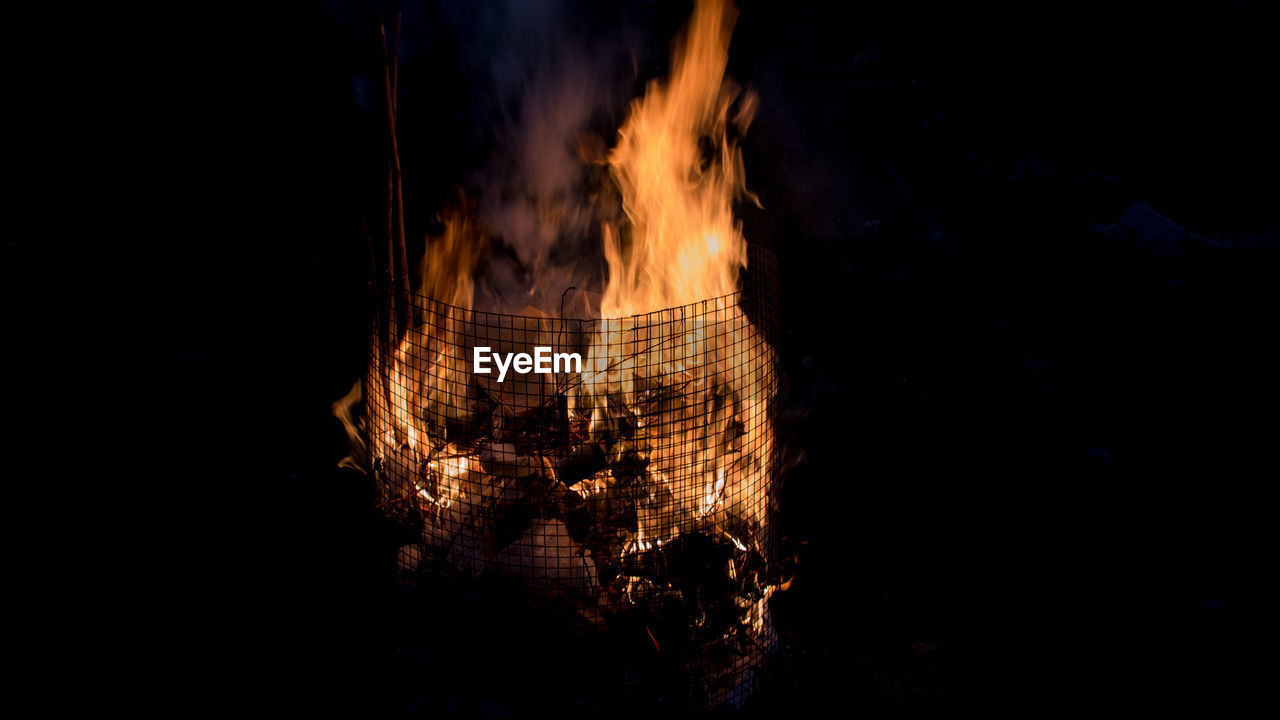 fire, burning, fire - natural phenomenon, heat - temperature, flame, night, motion, nature, no people, dark, orange color, log, copy space, glowing, wood, bonfire, firewood, wood - material, close-up, outdoors, black background