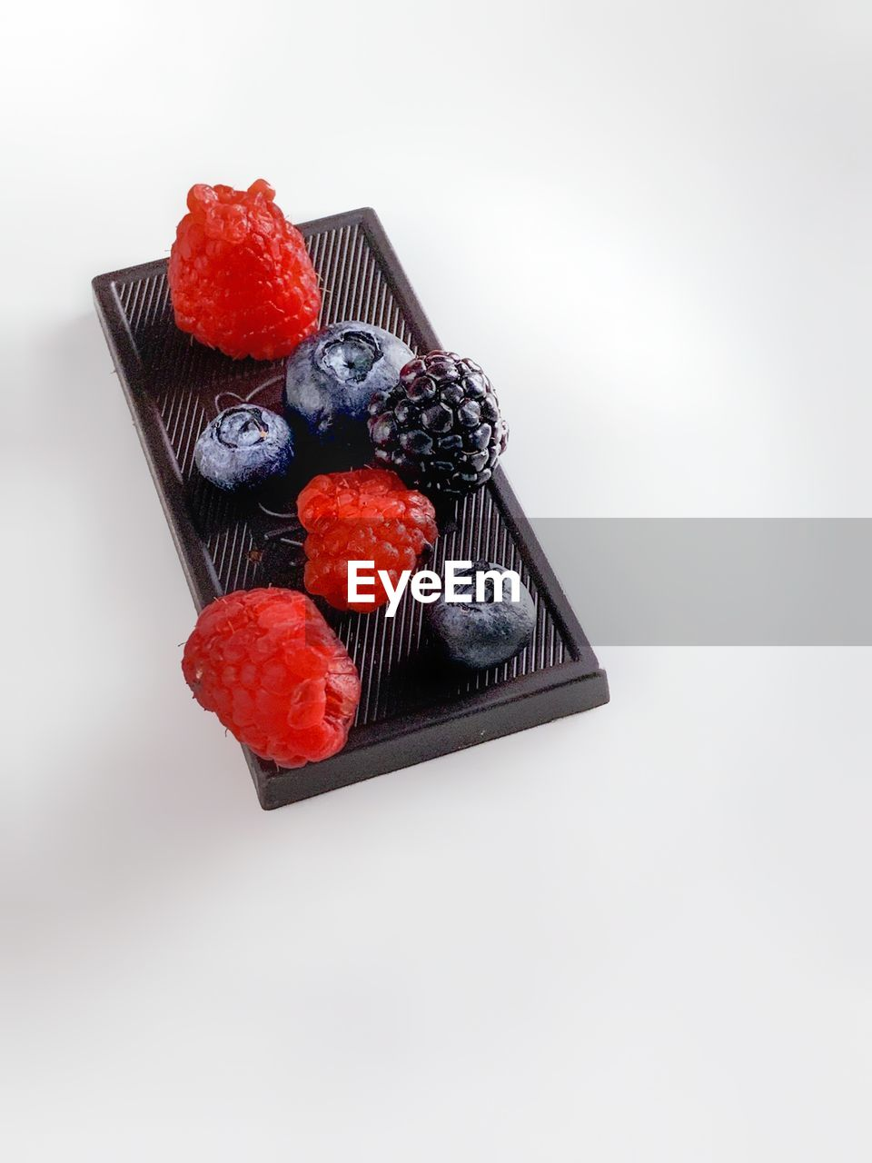 berry fruit, food, food and drink, fruit, white background, studio shot, sweet food, freshness, indulgence, strawberry, healthy eating, still life, temptation, sweet, ready-to-eat, indoors, copy space, blueberry, dessert, cake, no people, fruitcake