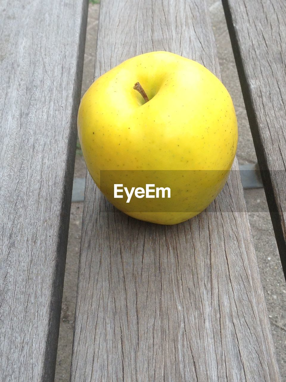 Close-Up Of Apple On Wooden Plank