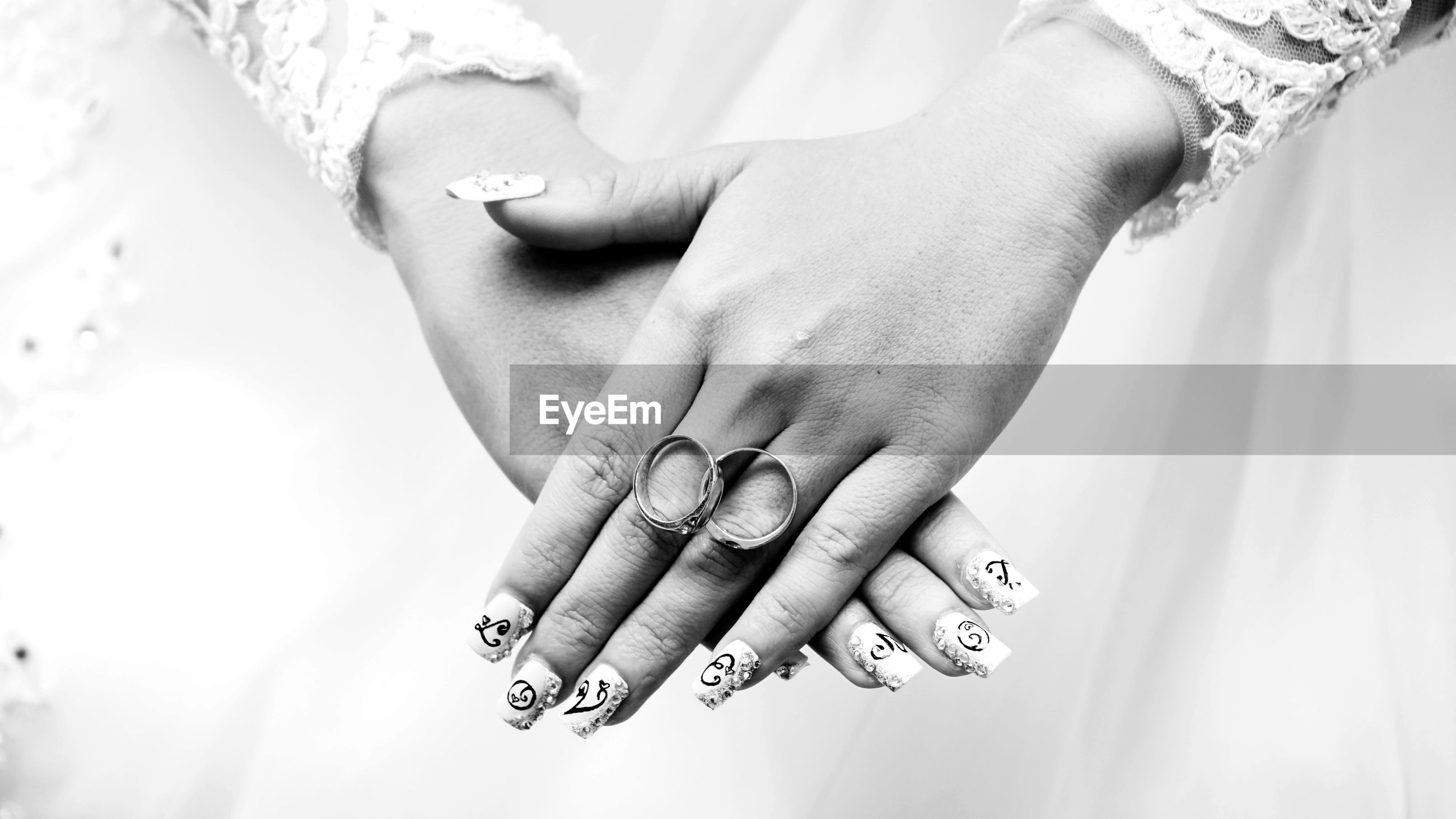 Close-up of wedding rings over bridegroom hands