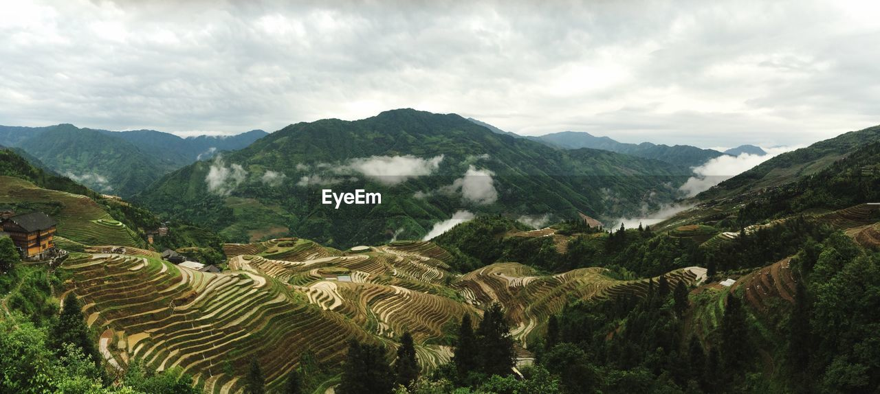 Scenic View Of Longsheng Rice Terrace Against Sky At Guangxi