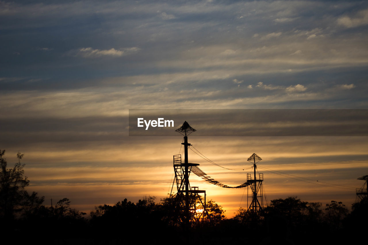 sunset, cloud - sky, sky, silhouette, technology, plant, tree, electricity pylon, beauty in nature, electricity, nature, connection, fuel and power generation, no people, scenics - nature, power line, power supply, cable, orange color, outdoors, electrical equipment