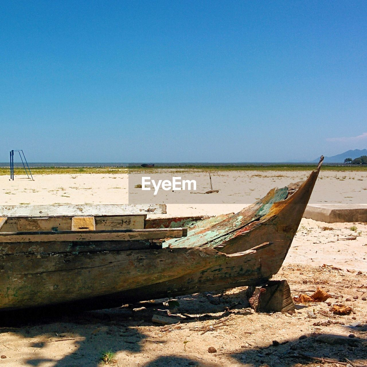 nautical vessel, transportation, mode of transport, boat, sand, moored, clear sky, beach, copy space, day, nature, no people, outdoors, water, blue, sunlight, longtail boat, scenics, sea, beauty in nature, sky