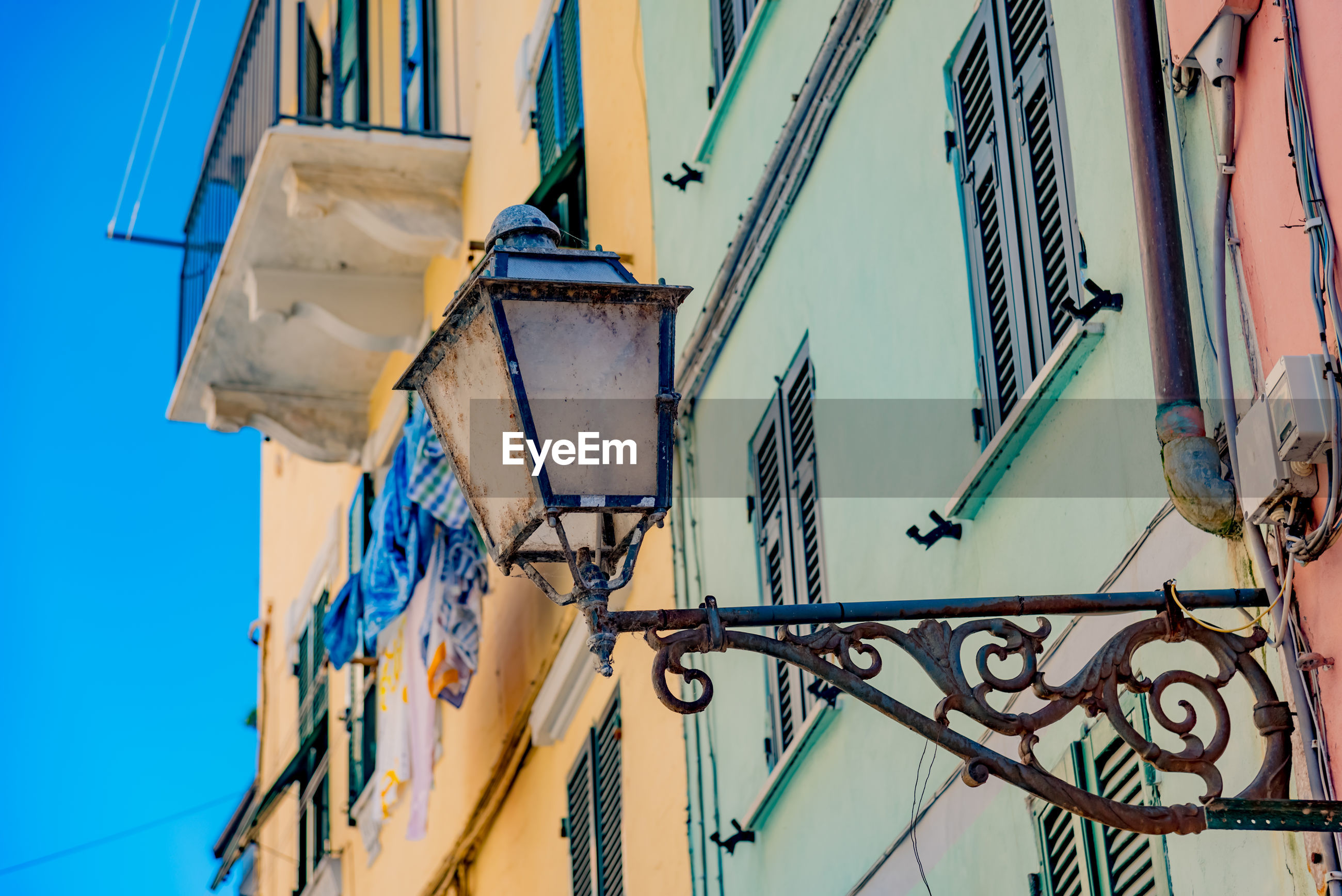 Low angle view of lighting equipment on building at riomaggiore