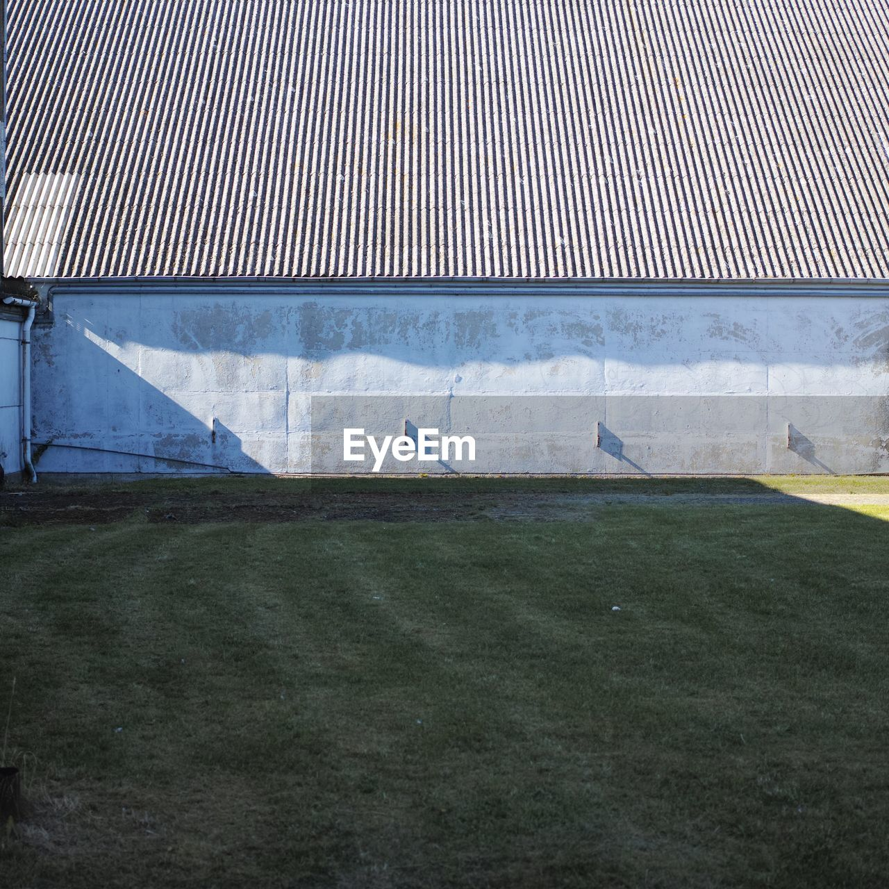 Exterior Of Building In Front Of Field During Sunny Day