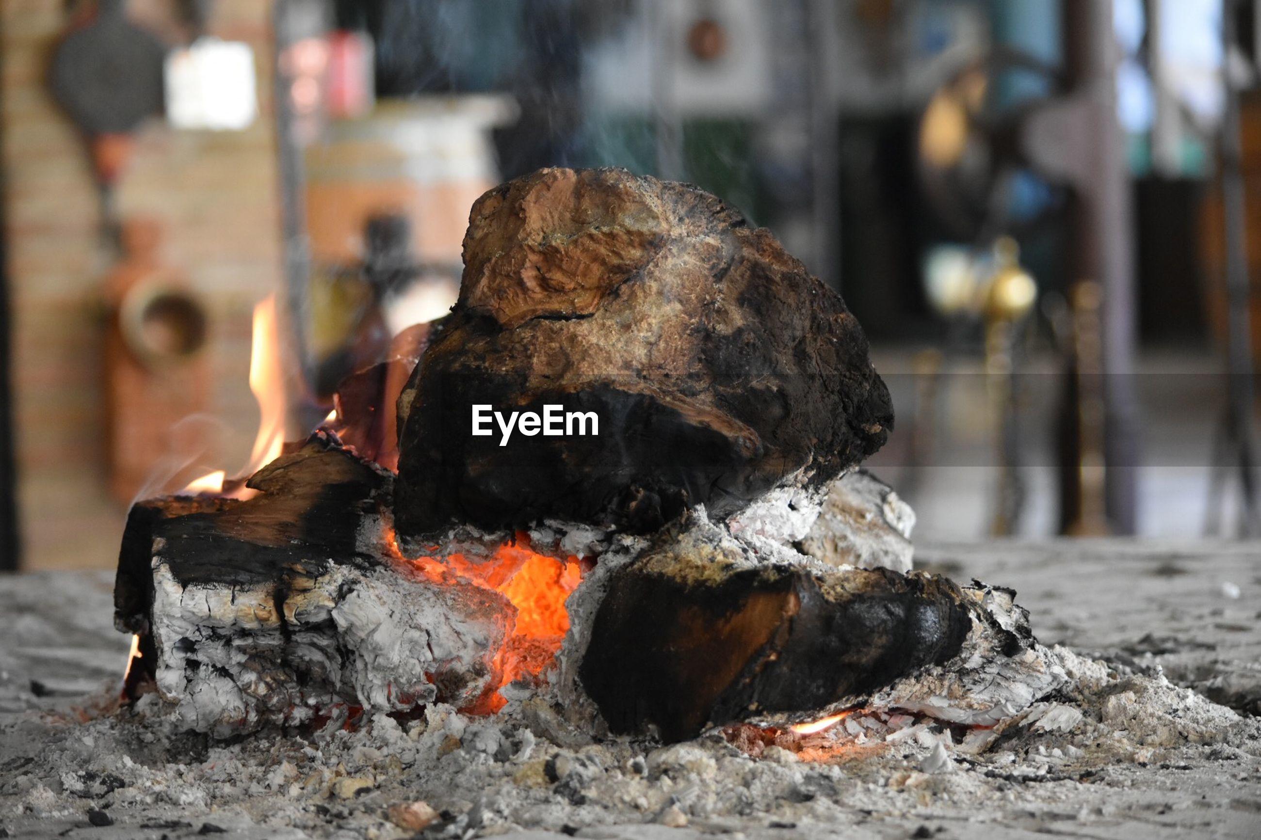 Firewood burning at fireplace