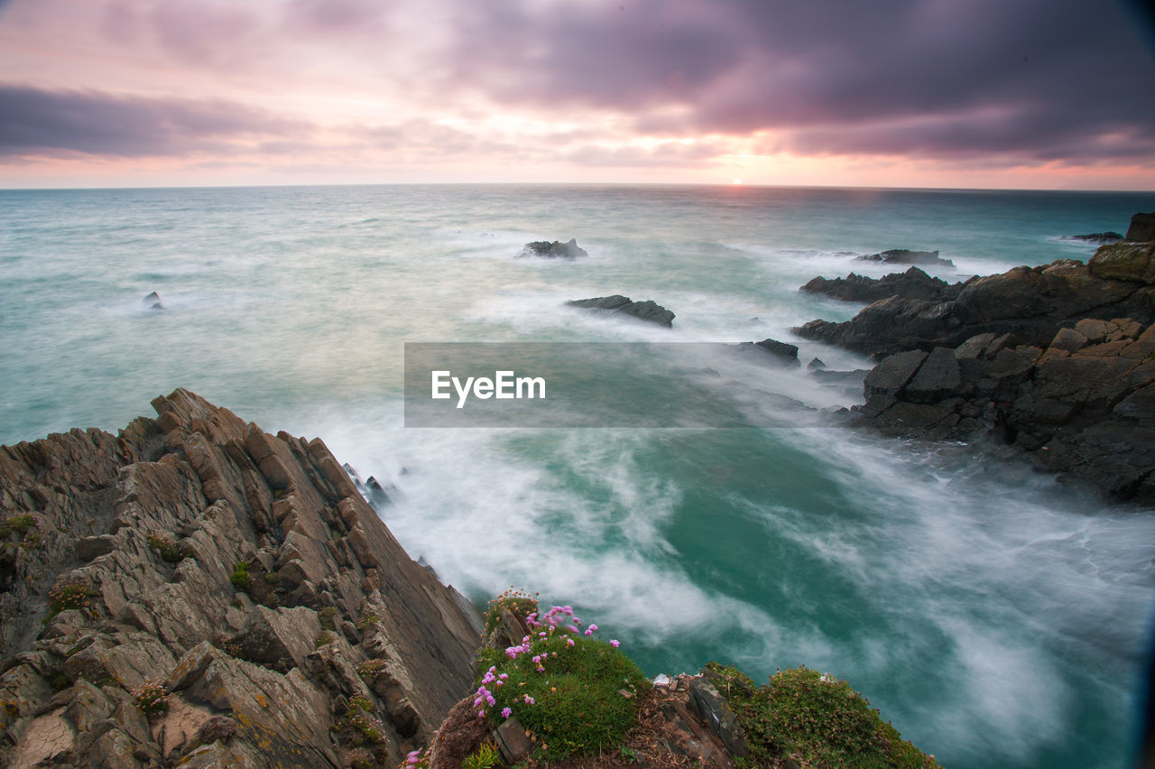 sea, water, sky, beauty in nature, scenics - nature, horizon over water, horizon, rock, solid, rock - object, cloud - sky, land, beach, tranquil scene, nature, tranquility, rock formation, motion, no people, outdoors, rocky coastline, power in nature, breaking