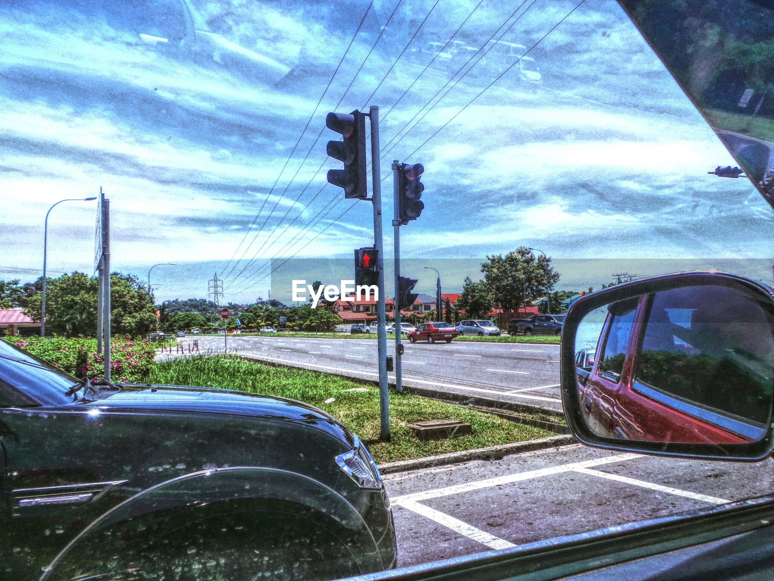 transportation, land vehicle, mode of transport, car, road, sky, tree, street, cloud - sky, road marking, blue, glass - material, cloud, day, sunlight, travel, vehicle interior, no people, windshield, parking