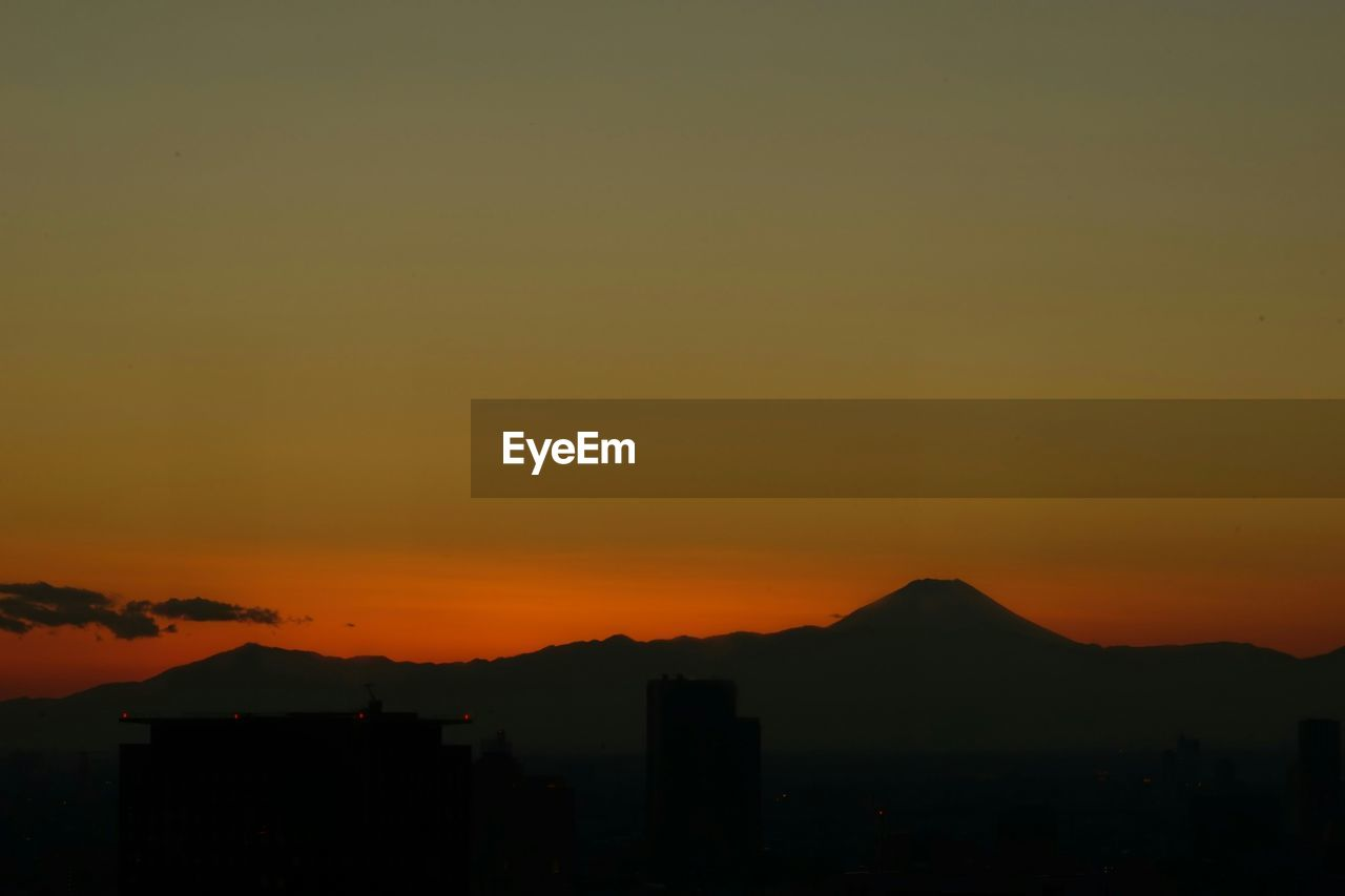sunset, silhouette, architecture, cityscape, no people, city, building exterior, built structure, sky, nature, mountain, outdoors, beauty in nature, skyscraper