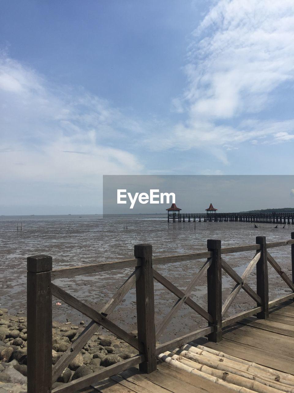 sky, water, cloud - sky, sea, built structure, railing, architecture, day, nature, horizon, tranquility, scenics - nature, beauty in nature, horizon over water, tranquil scene, building exterior, pier, wood - material, travel destinations, outdoors