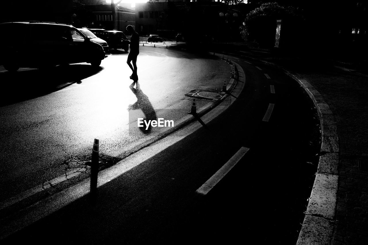 Full length of silhouette man walking on street