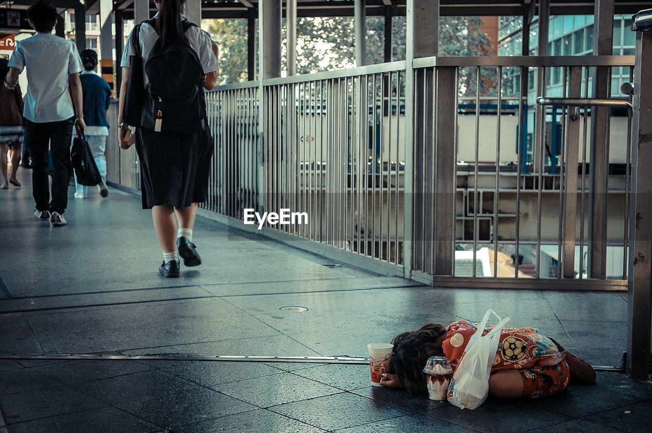 High angle view of homeless girl on bridge