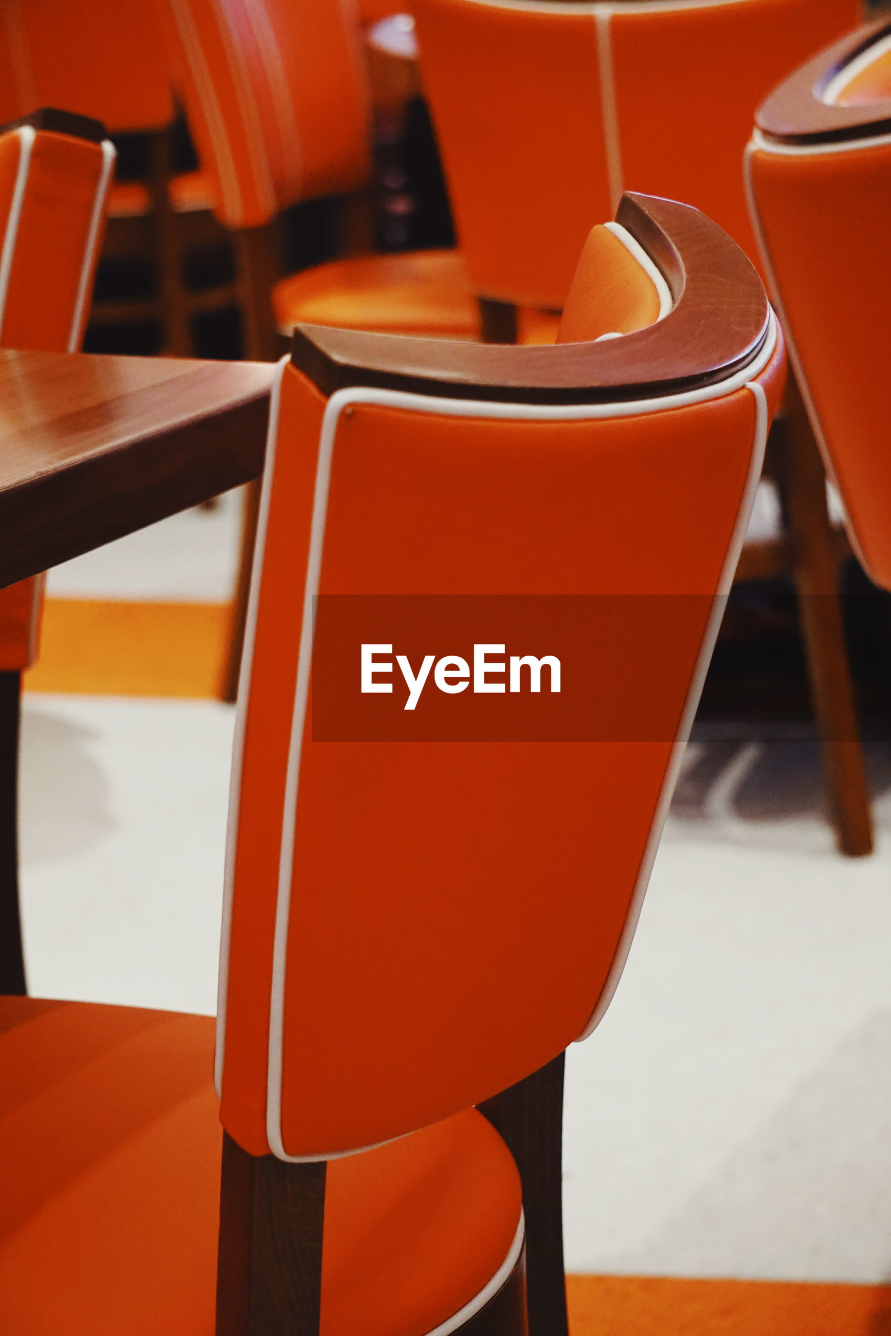 Close-up of empty chairs and table at restaurant