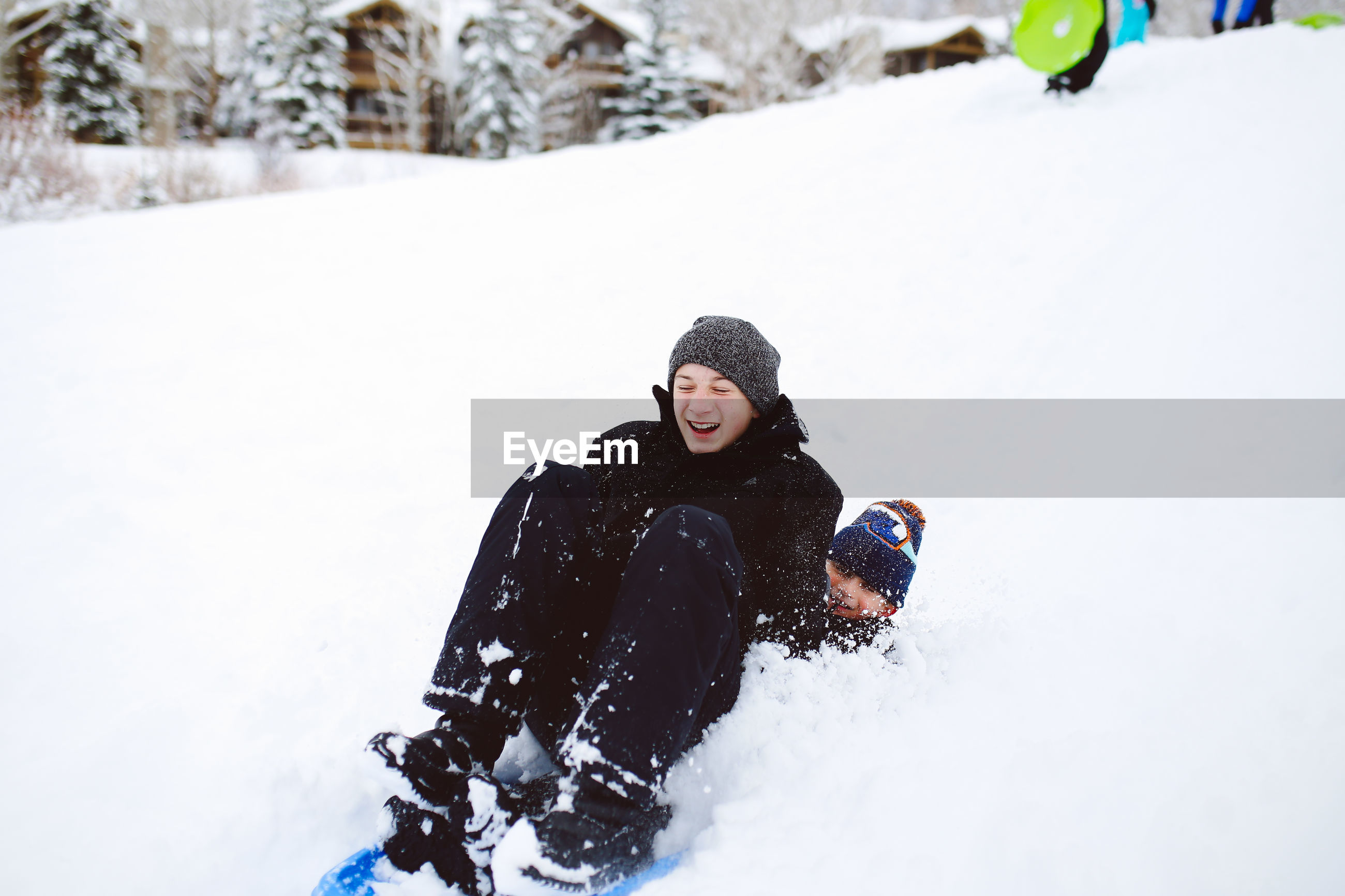 YOUNG WOMAN COVERED WITH SNOW ON FIELD