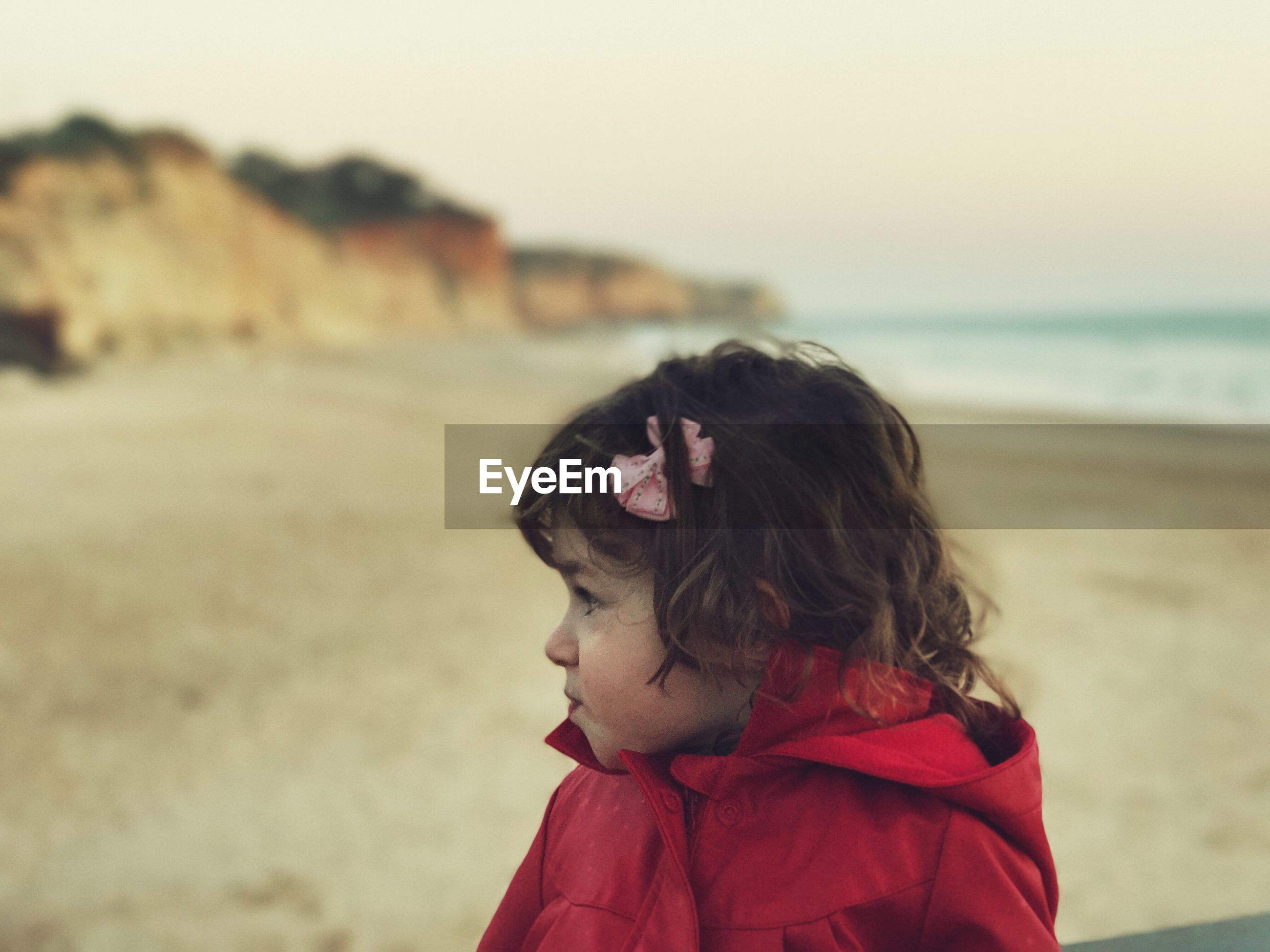 Close-up of girl looking away at beach