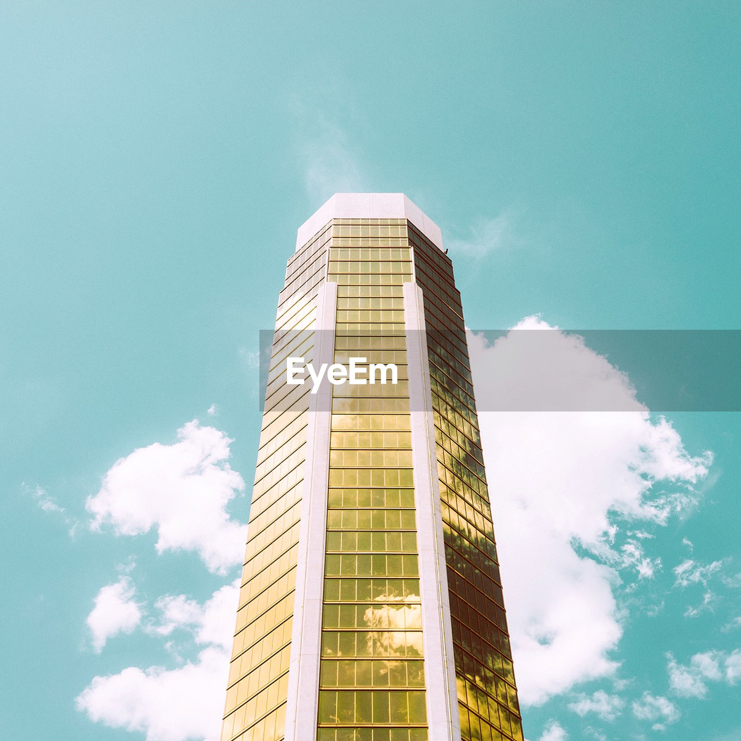 architecture, low angle view, building exterior, built structure, sky, modern, tall - high, office building, tower, city, building, skyscraper, blue, cloud, cloud - sky, tall, glass - material, day, window, outdoors