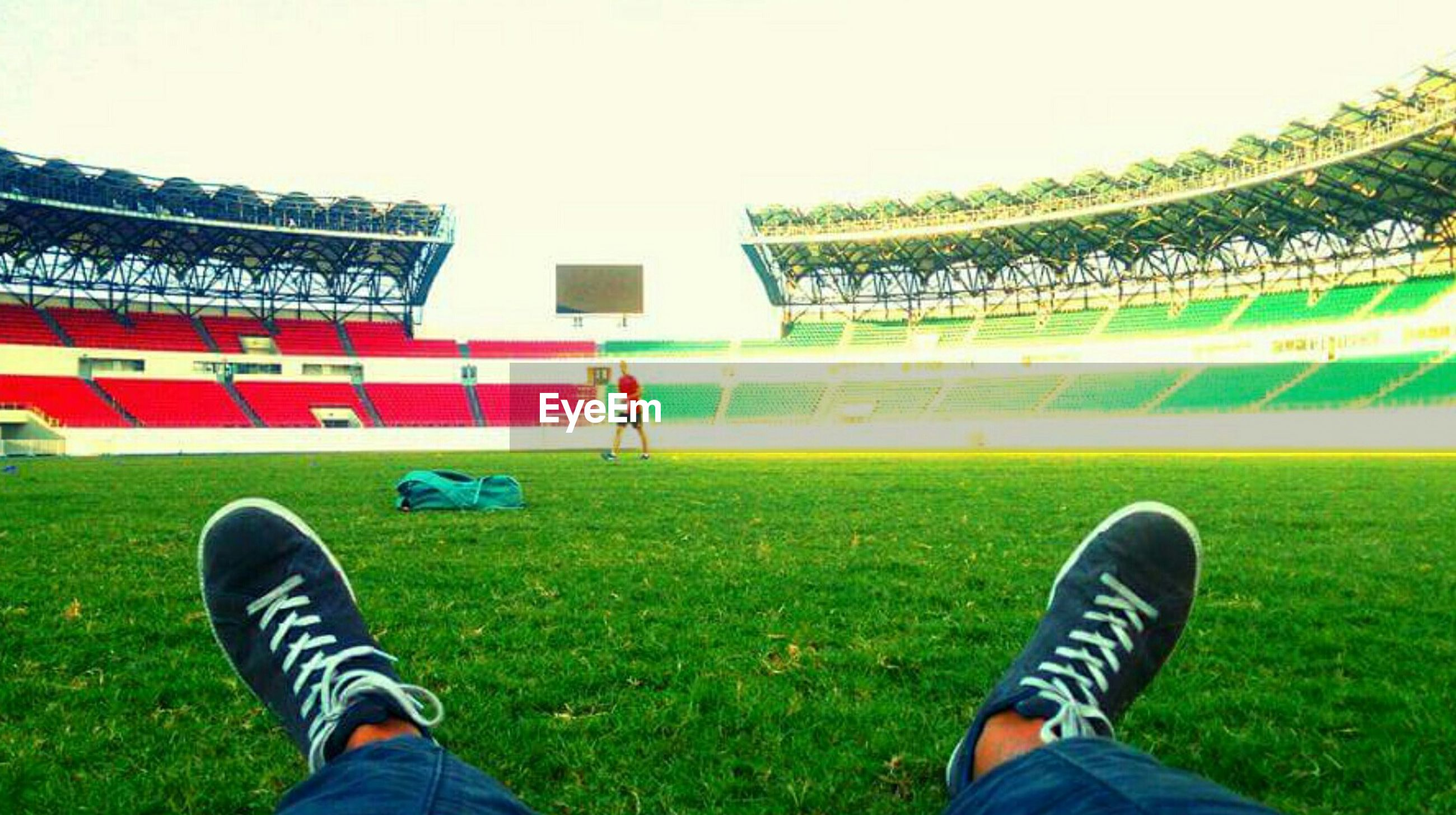 low section, person, grass, shoe, personal perspective, lifestyles, grassy, leisure activity, field, standing, footwear, green color, human foot, unrecognizable person, casual clothing, sport, day, lawn, outdoors, part of, green, landscape, sky, nature, growth