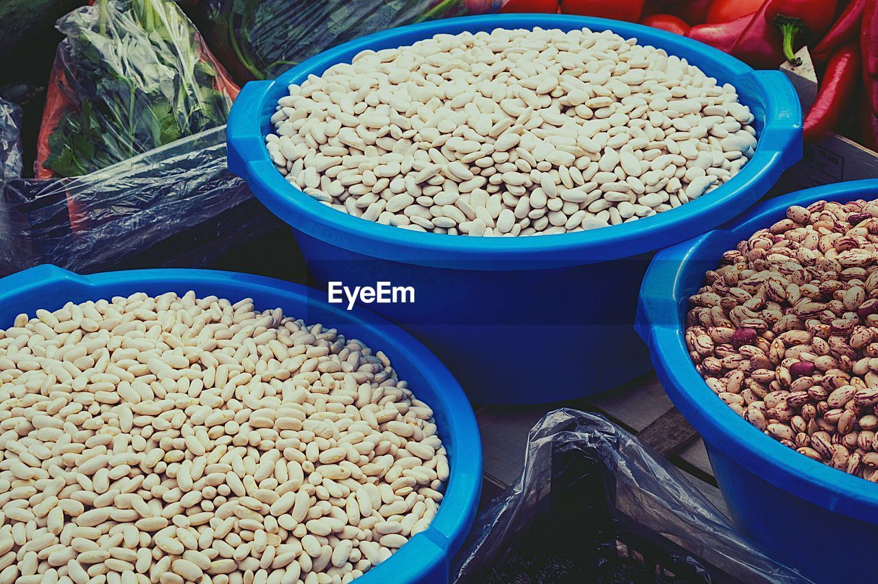 High angle view of pinto beans and cannellini beans in bowl at market