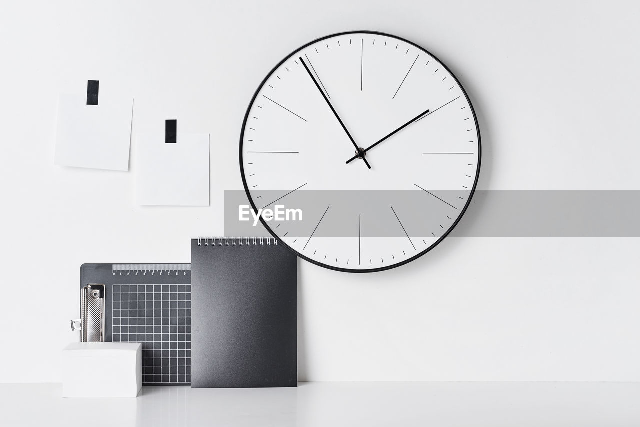 clock, time, wall - building feature, instrument of time, indoors, geometric shape, no people, technology, minute hand, wall clock, white color, shape, circle, clock face, accuracy, close-up, architecture, built structure, number, communication