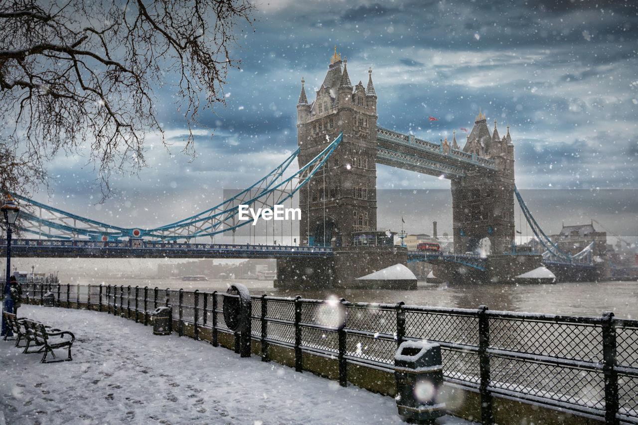 Tower bridge over thames river during snowfall