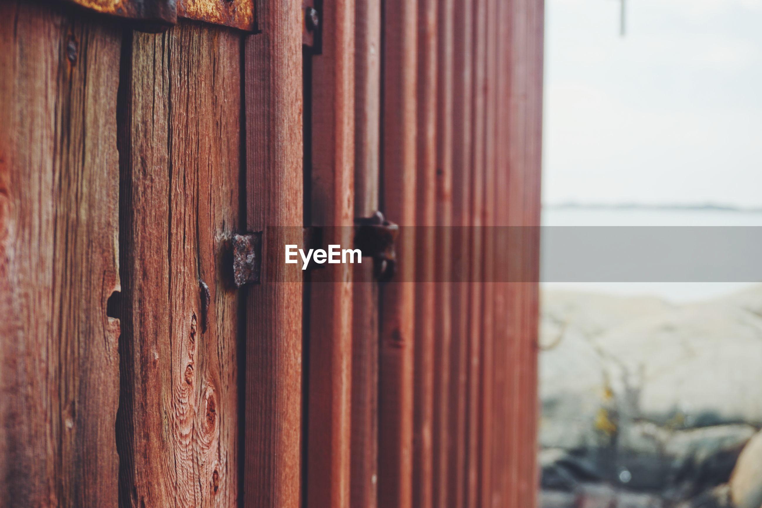 Close-up of rusty metal on door