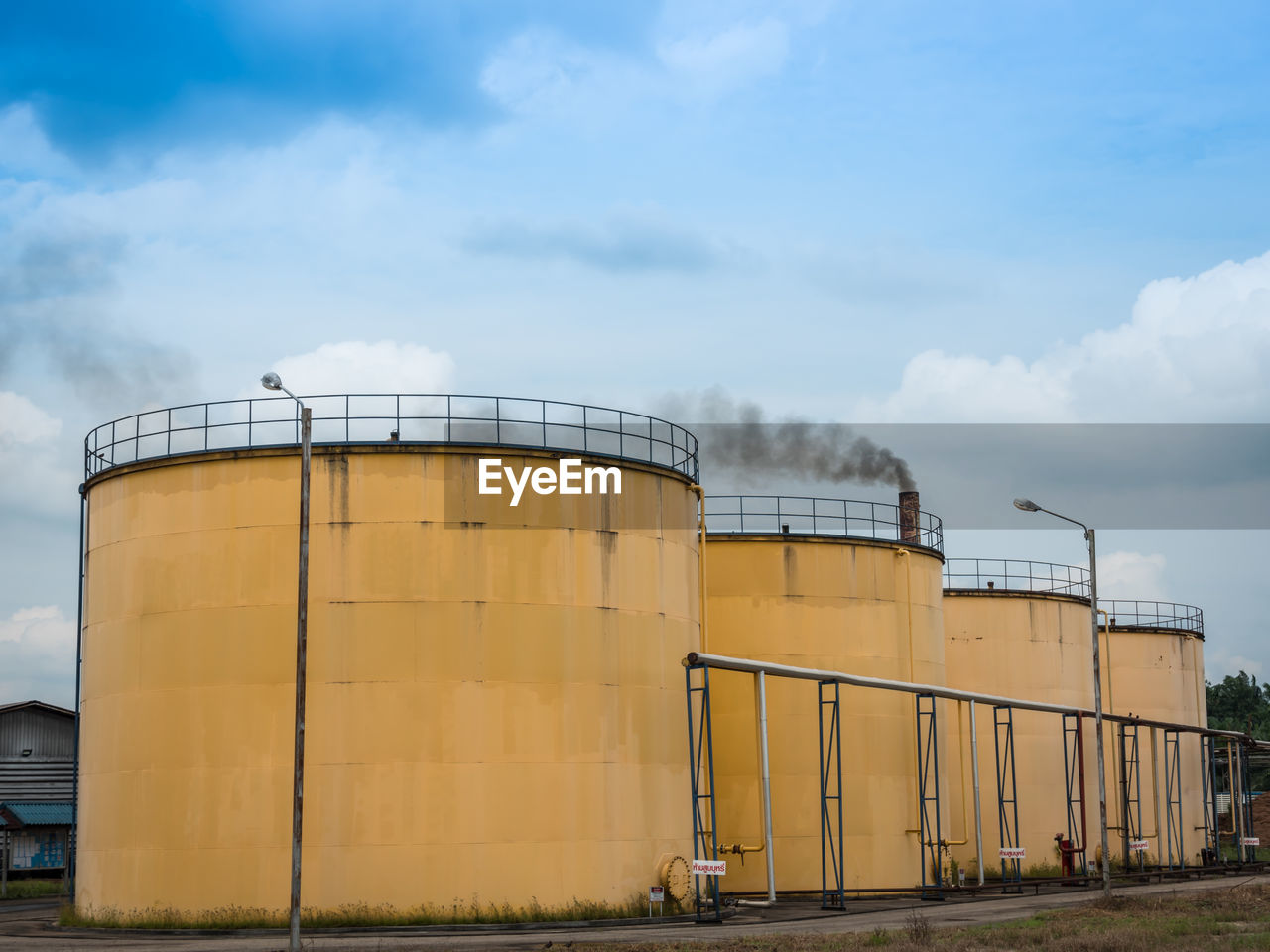sky, industry, cloud - sky, factory, storage compartment, storage tank, fuel and power generation, container, nature, oil industry, day, architecture, no people, built structure, outdoors, fuel storage tank, silo, technology, refinery, warehouse, industrial equipment, chemical plant