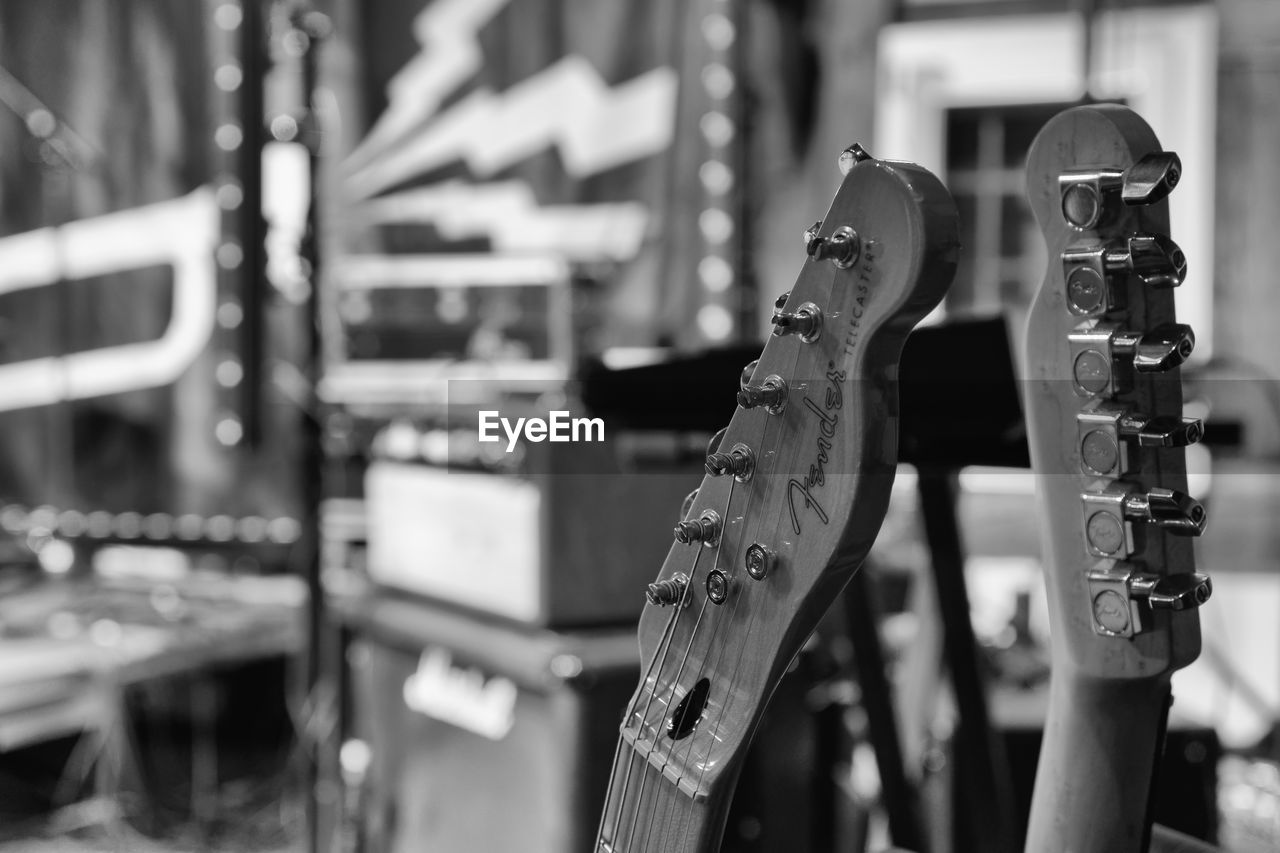 focus on foreground, metal, no people, close-up, in a row, arts culture and entertainment, still life, for sale, indoors, hanging, store, shopping, group of objects, retail, musical equipment, representation, chain, selective focus, musical instrument, string instrument