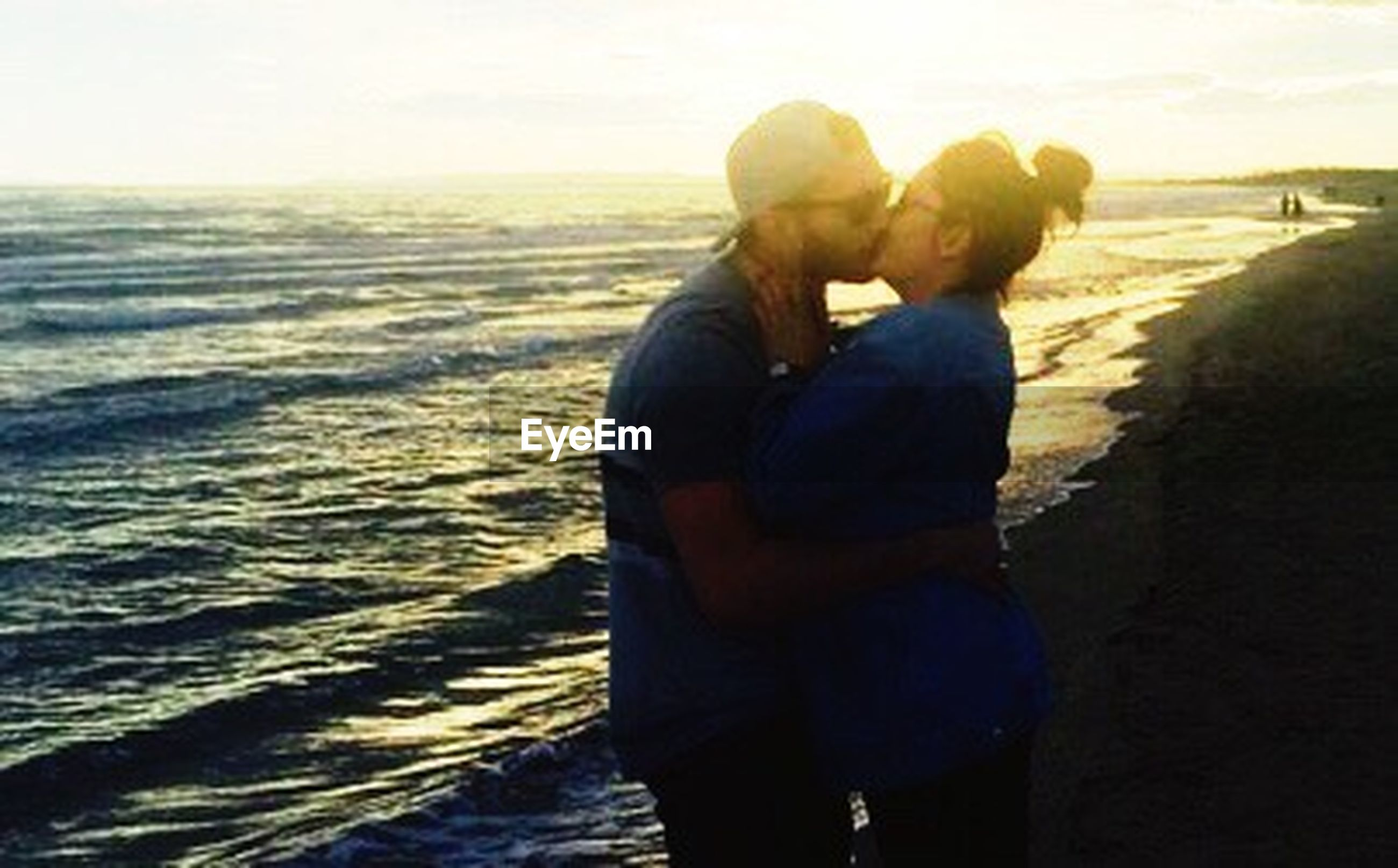 two people, love, heterosexual couple, romance, togetherness, men, embracing, adults only, sea, bonding, couple - relationship, sunset, women, people, happiness, adult, beach, care, outdoors, vacations, young adult, nature, sky, day