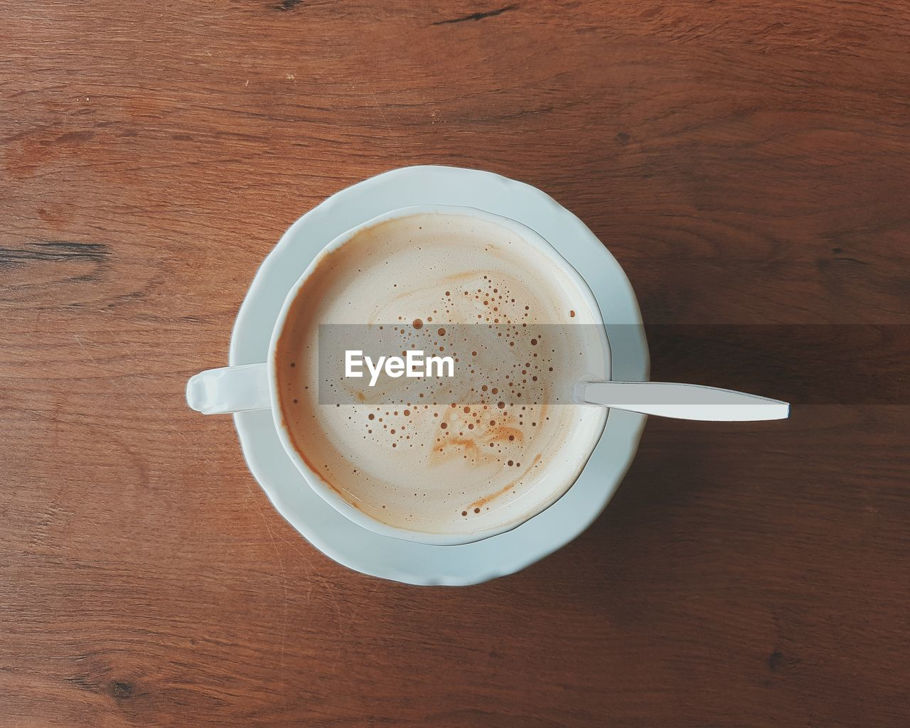 drink, refreshment, table, food and drink, coffee cup, coffee - drink, cup, directly above, high angle view, freshness, frothy drink, saucer, indoors, beverage, no people, close-up, day