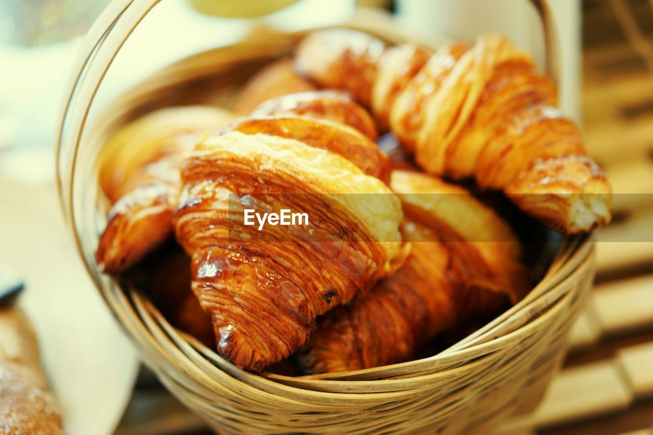 food and drink, food, croissant, french food, still life, close-up, container, freshness, baked, indoors, basket, no people, wicker, brown, table, selective focus, healthy eating, ready-to-eat, wellbeing, focus on foreground, temptation, snack