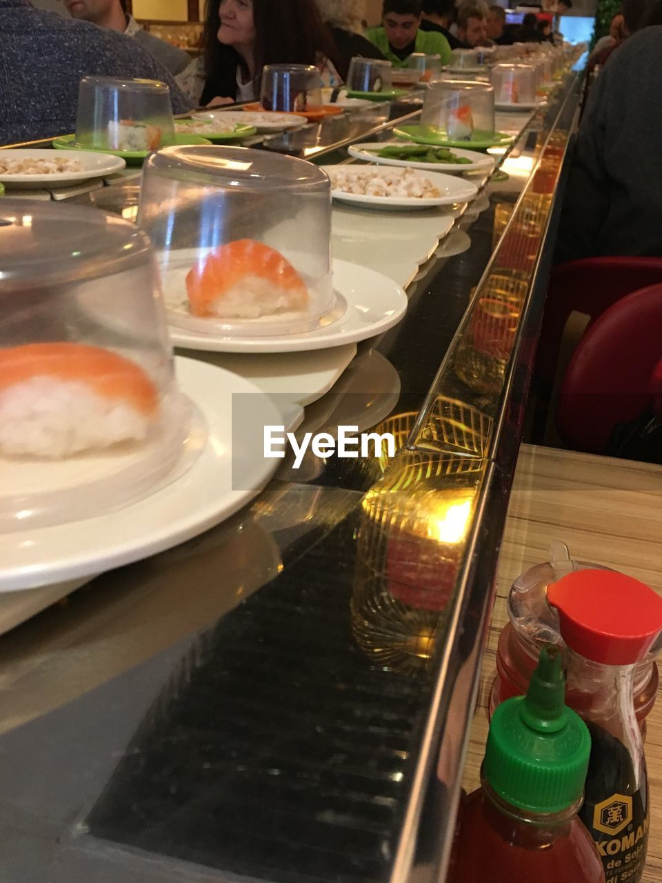 food and drink, food, freshness, incidental people, restaurant, business, indoors, plate, container, close-up, kitchen utensil, table, kitchen, household equipment, real people, ready-to-eat, serving size, healthy eating, bowl, meal, crockery, preparing food, chef