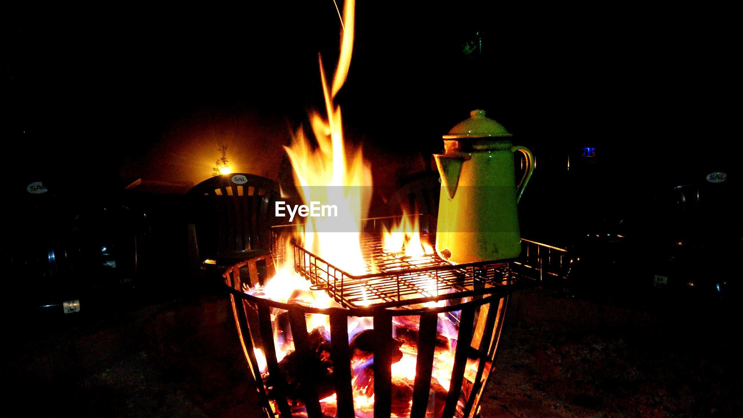 CLOSE-UP OF ILLUMINATED BURNING CANDLES