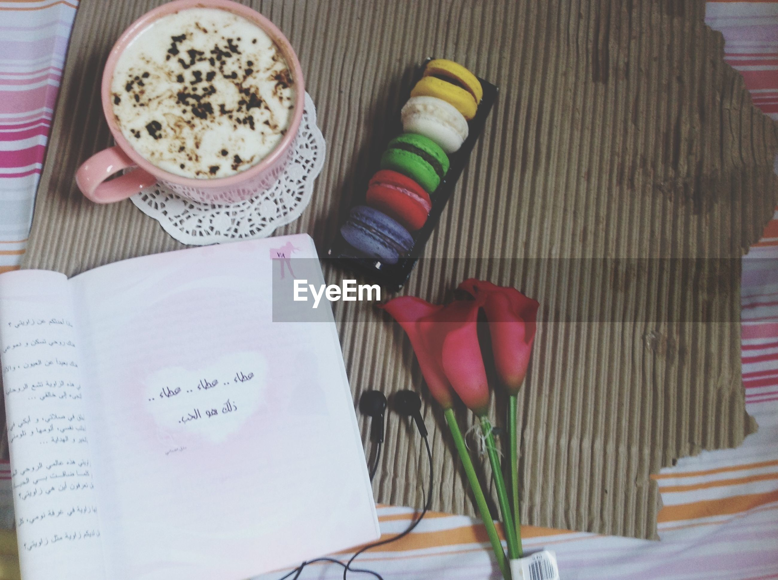 indoors, food and drink, table, freshness, still life, food, high angle view, drink, book, refreshment, healthy eating, coffee cup, close-up, plate, ready-to-eat, bowl, paper, fork, text, coffee - drink