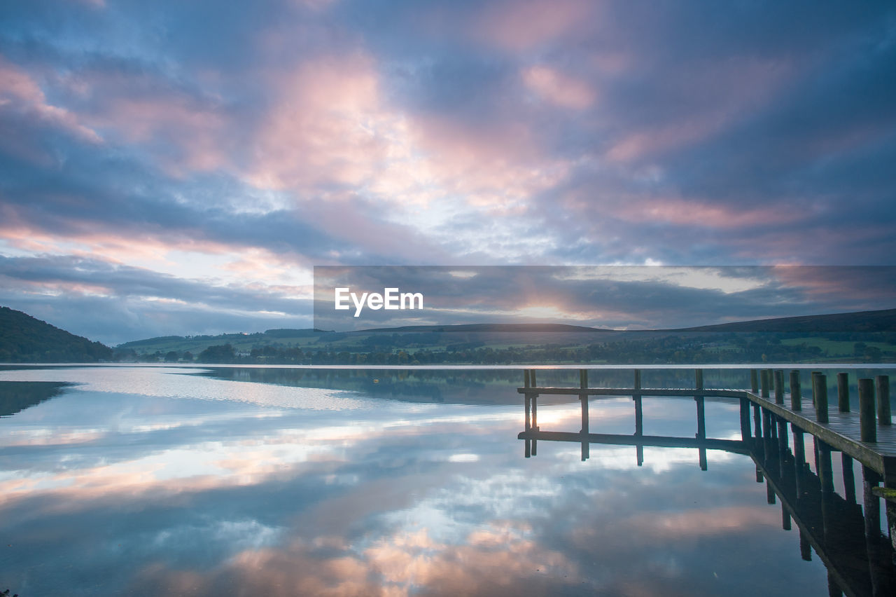 sky, cloud - sky, water, beauty in nature, lake, scenics - nature, tranquility, reflection, tranquil scene, nature, mountain, non-urban scene, sunset, no people, waterfront, idyllic, outdoors, remote