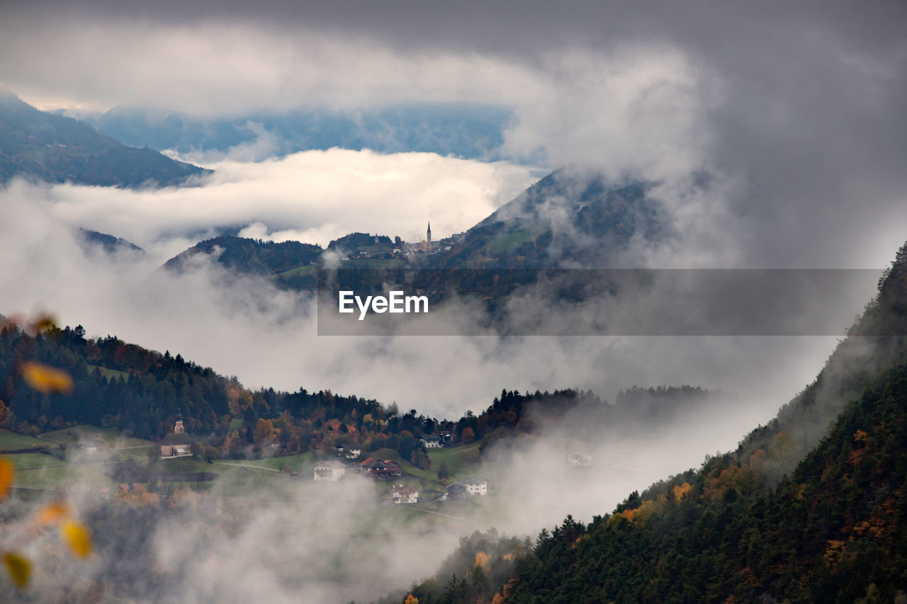 mountain, cloud - sky, sky, beauty in nature, scenics - nature, tree, day, nature, no people, mountain range, tranquil scene, plant, fog, environment, tranquility, outdoors, non-urban scene, architecture, building exterior