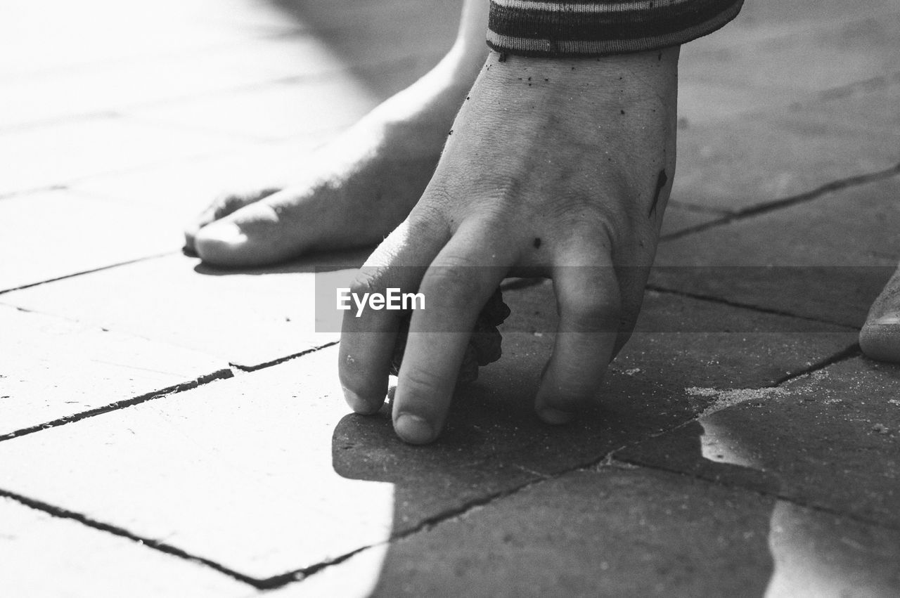 Person Playing On Paving Stone