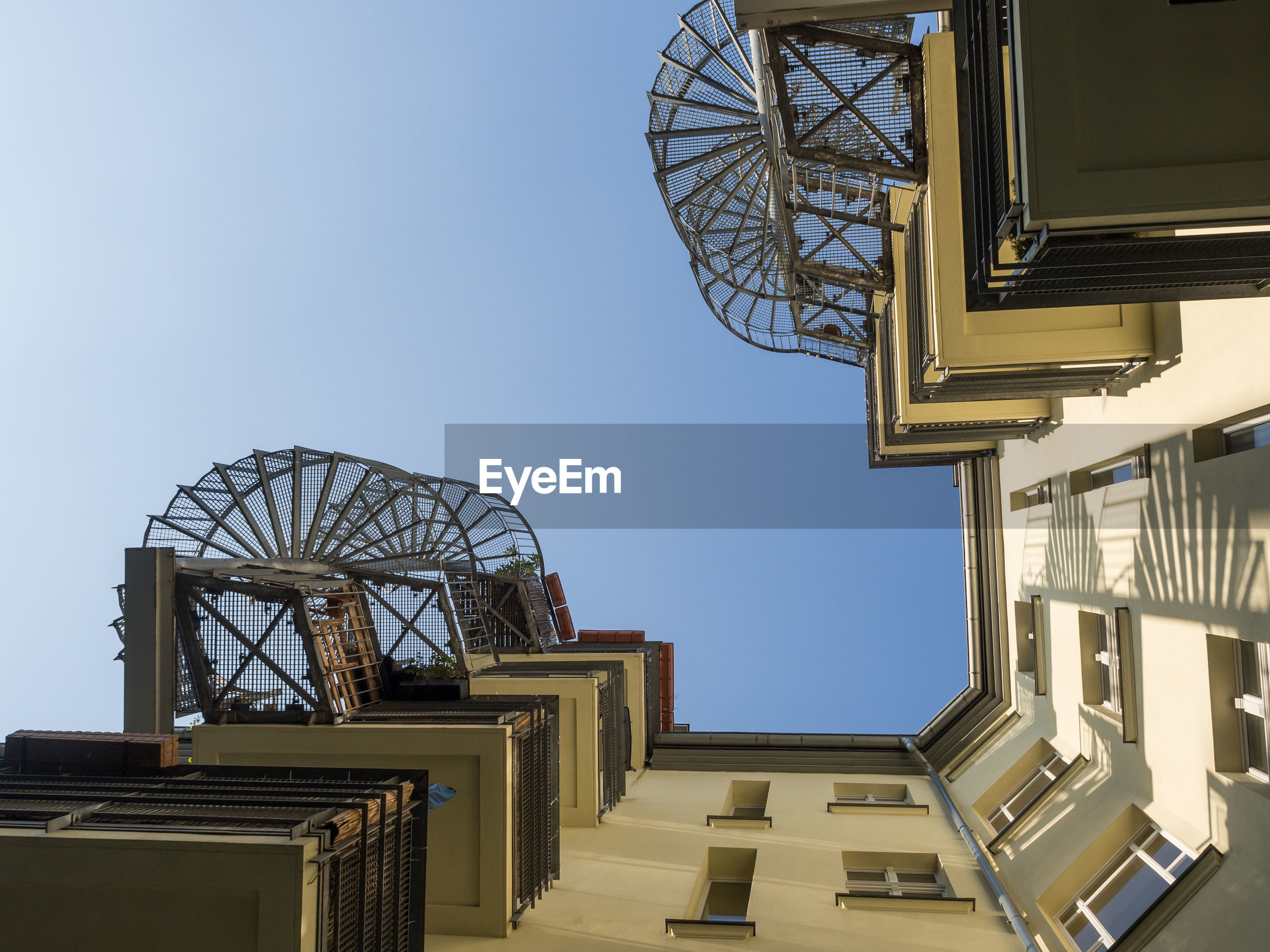 Low angle view of balconies against blue sky