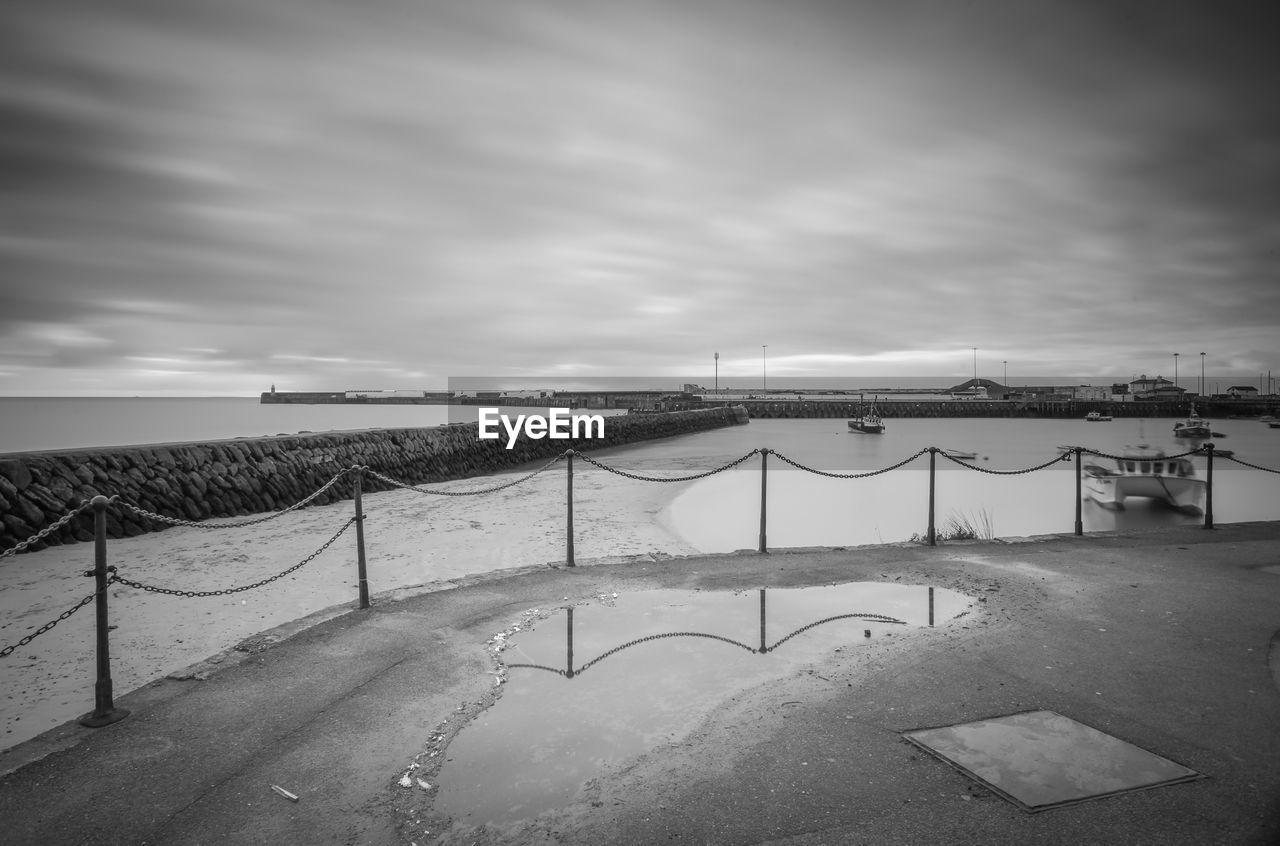 Folkestone harbor against cloudy sky