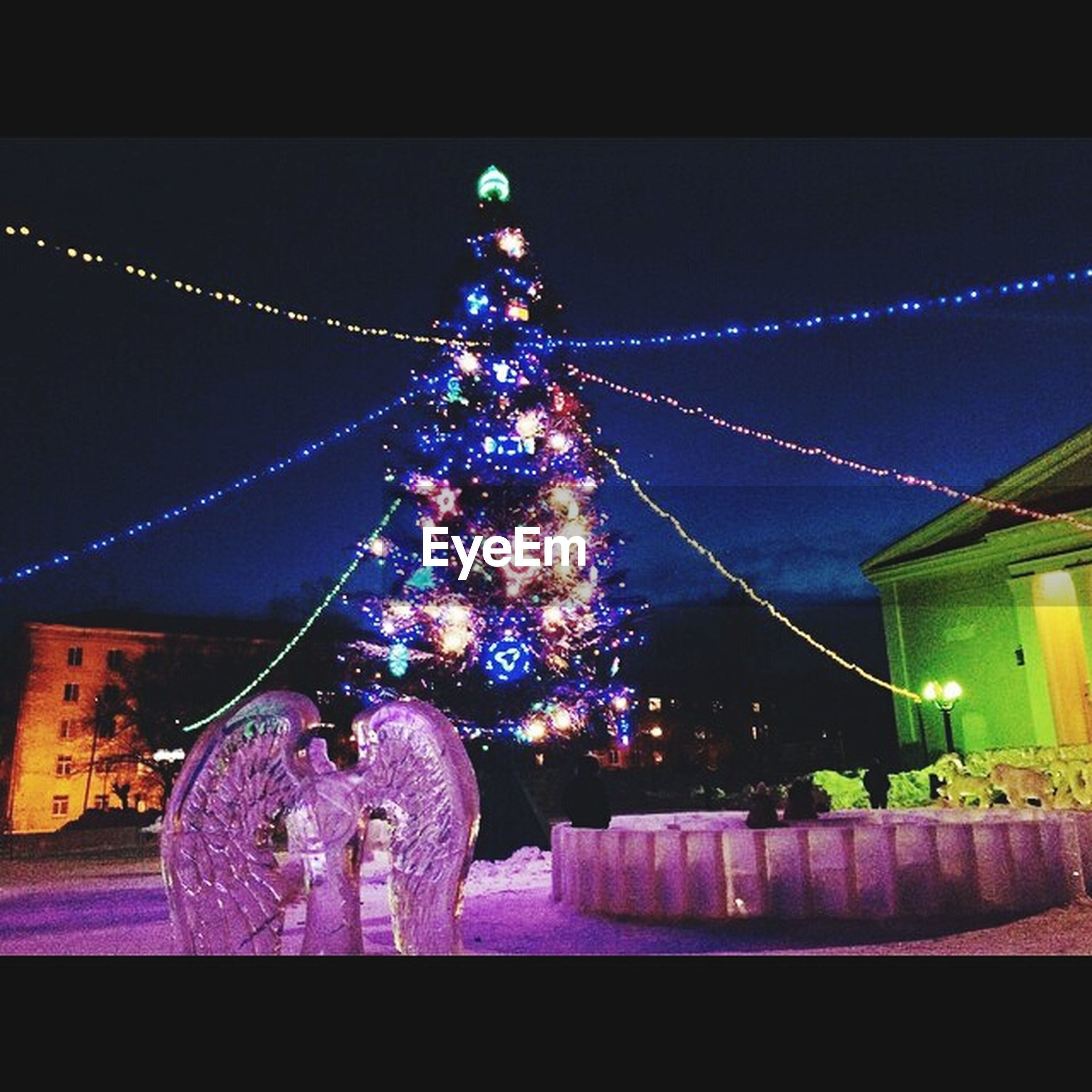 illuminated, night, decoration, celebration, low angle view, lighting equipment, christmas decoration, christmas lights, christmas, multi colored, architecture, hanging, built structure, christmas tree, building exterior, tradition, decor, arts culture and entertainment, amusement park, glowing