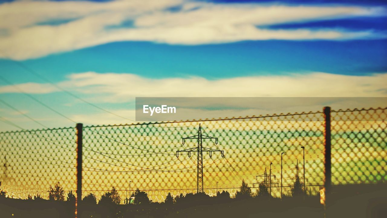 sky, cloud - sky, fence, silhouette, sunset, nature, barrier, boundary, outdoors, land, sport, no people, beauty in nature, scenics - nature, security, chainlink fence, safety, orange color, protection, net - sports equipment, power supply