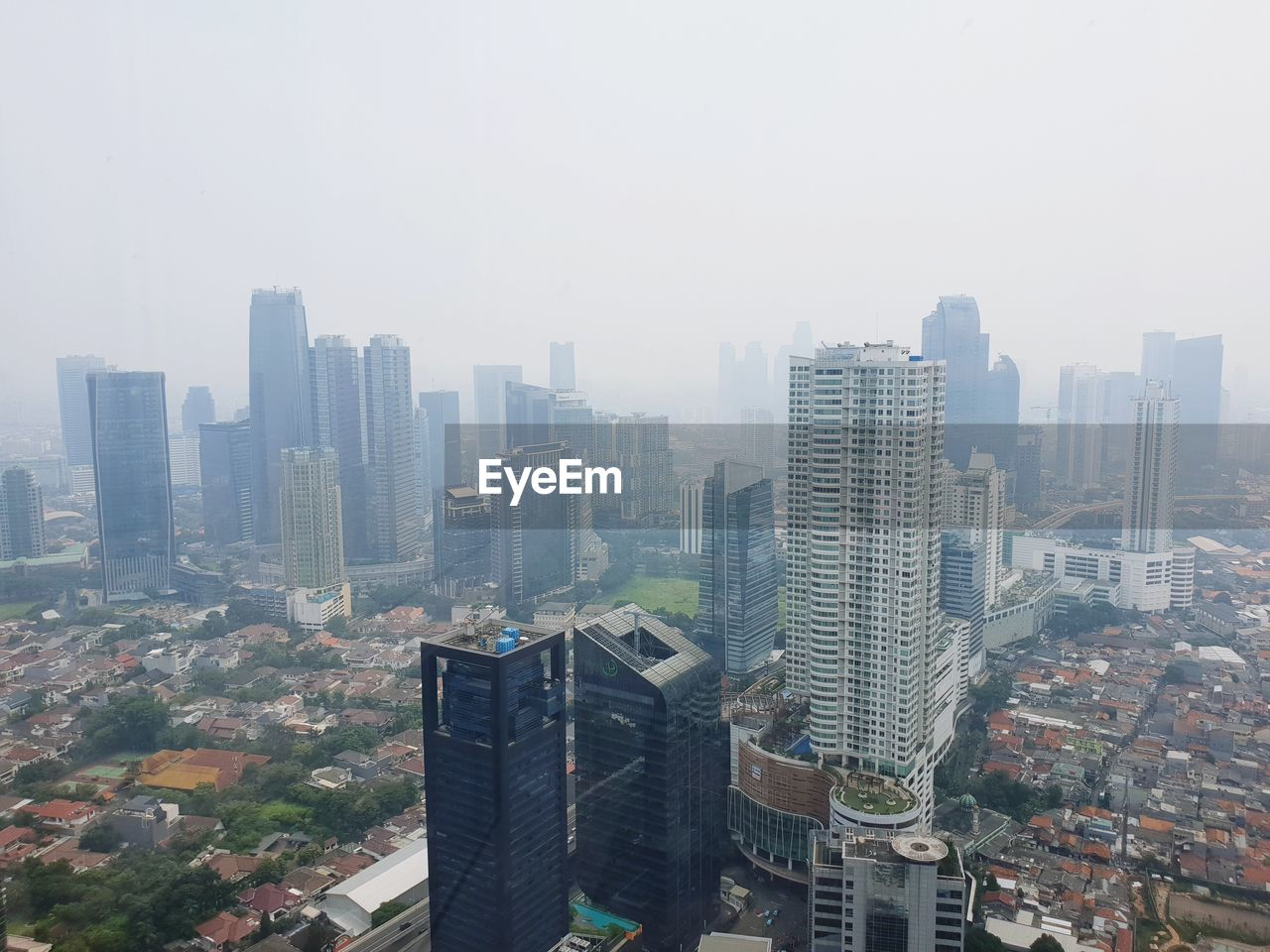 building exterior, built structure, architecture, city, building, cityscape, sky, residential district, crowd, office building exterior, skyscraper, nature, fog, crowded, tall - high, day, landscape, outdoors, high angle view, modern, financial district, settlement