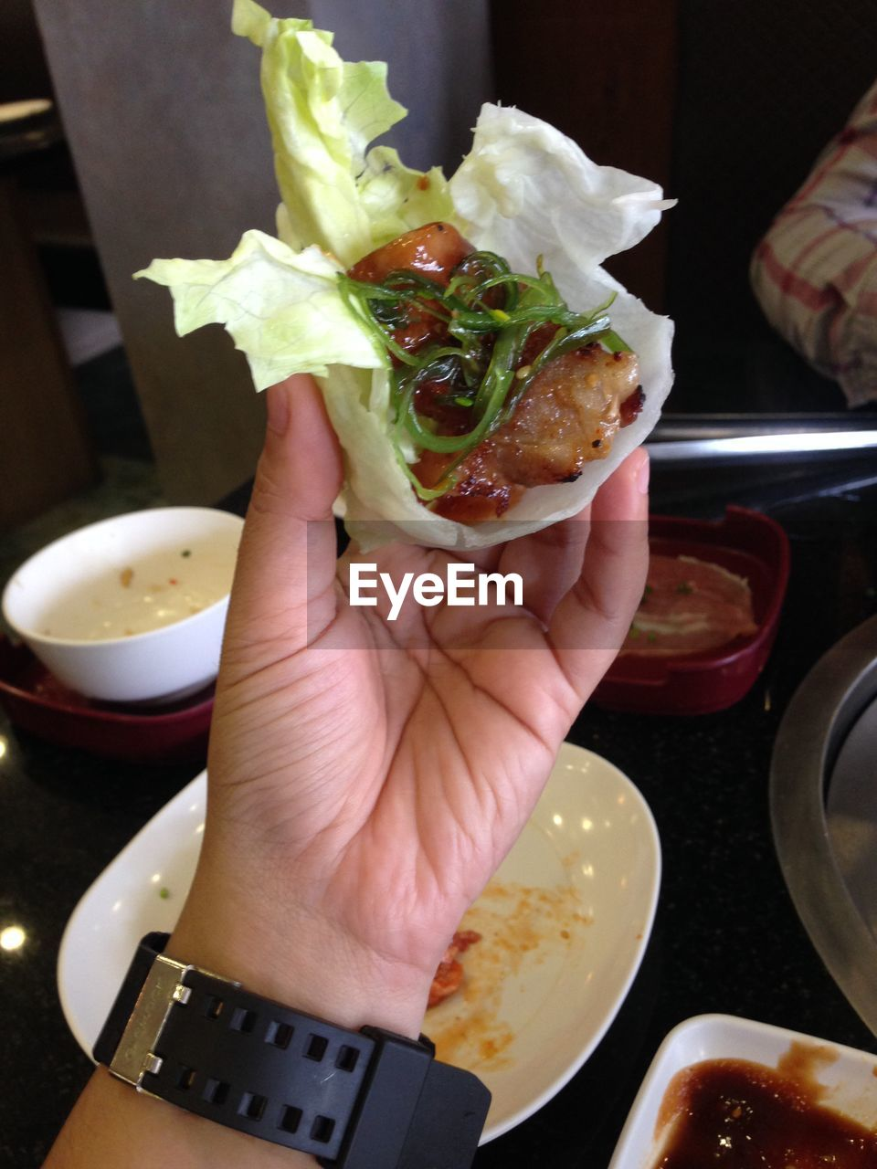 Close-up of person eating stuffed food