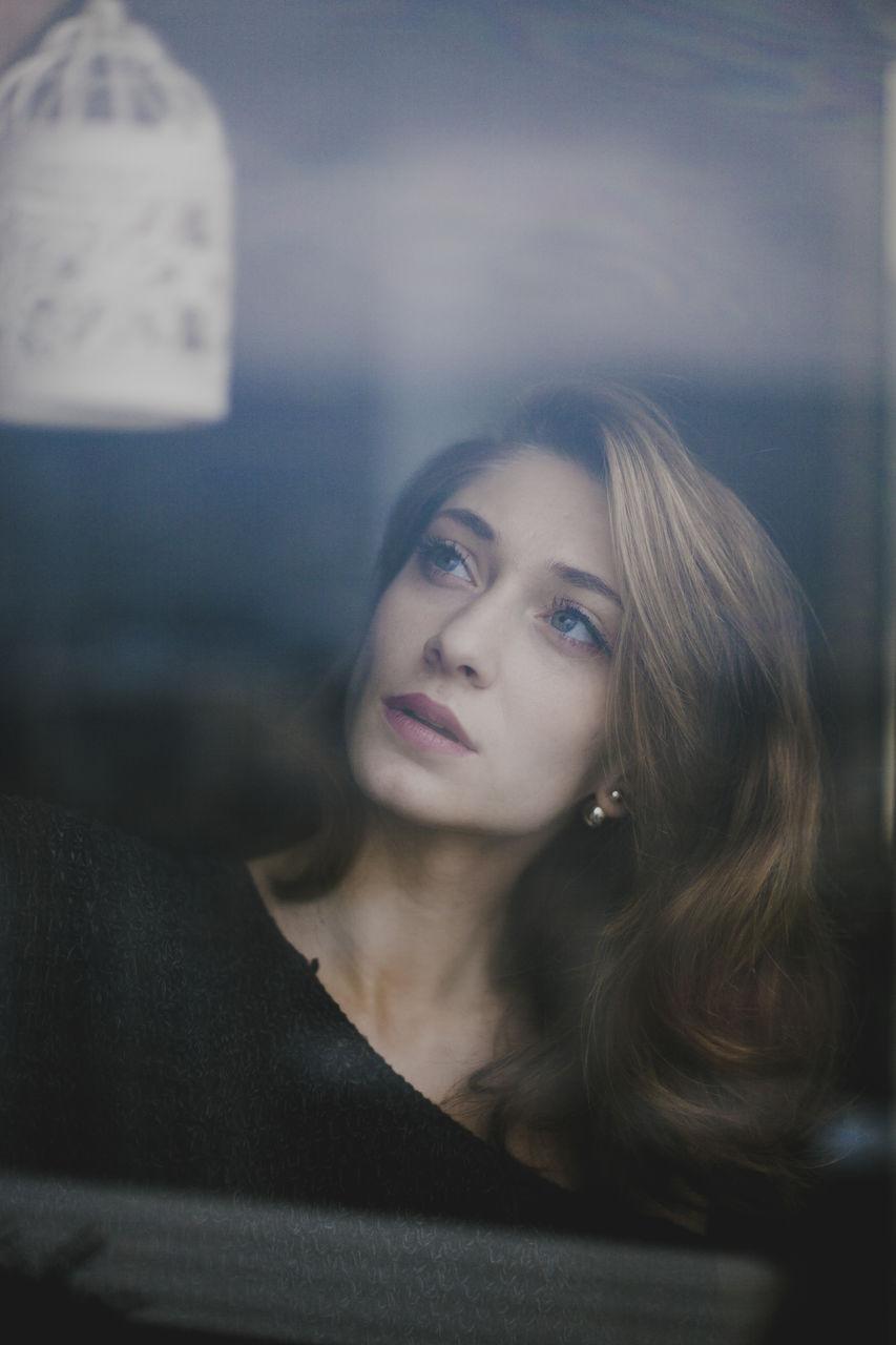 Close-Up Of Beautiful Woman At Home