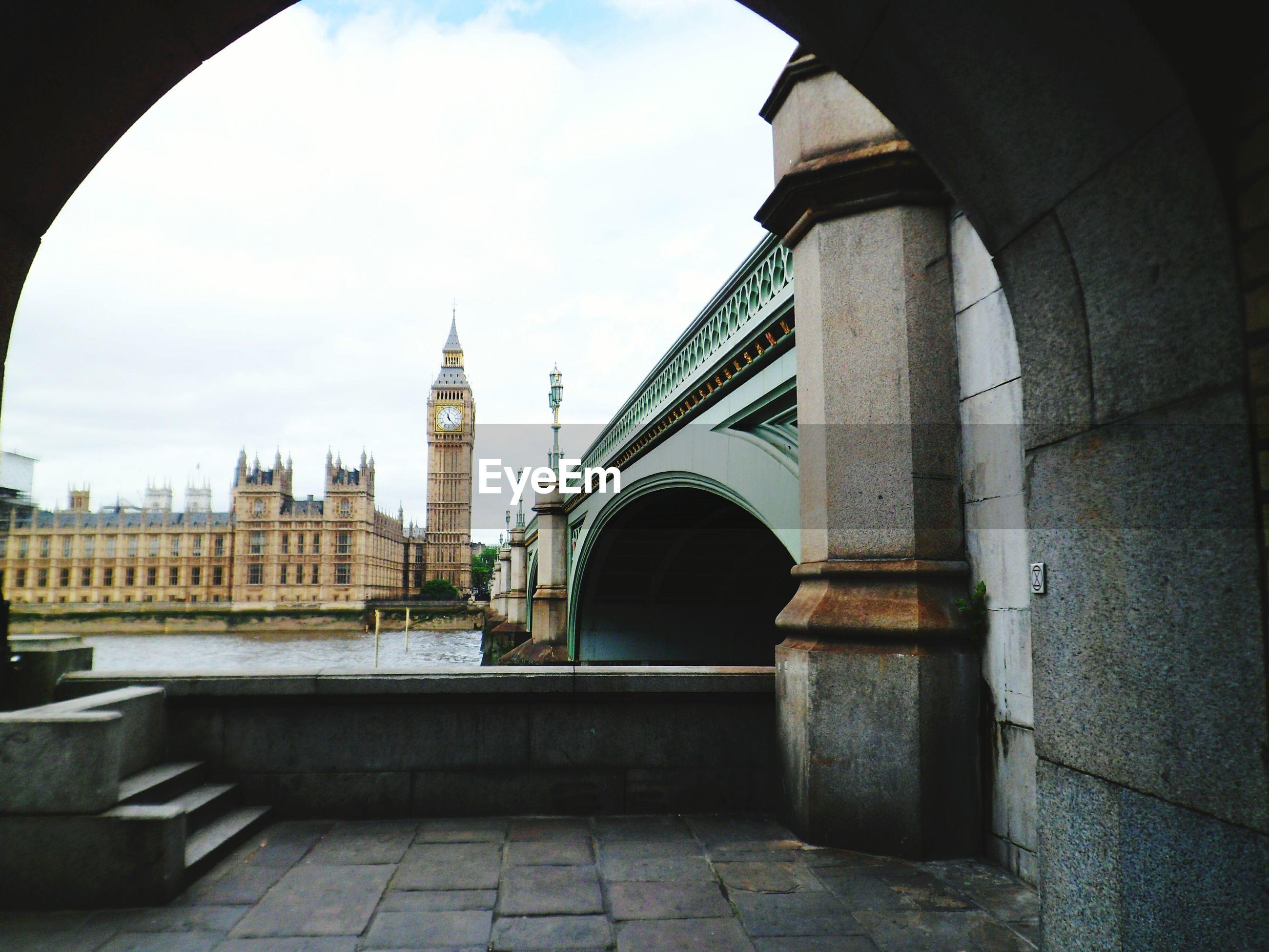 Big ben seen through bridge against sky